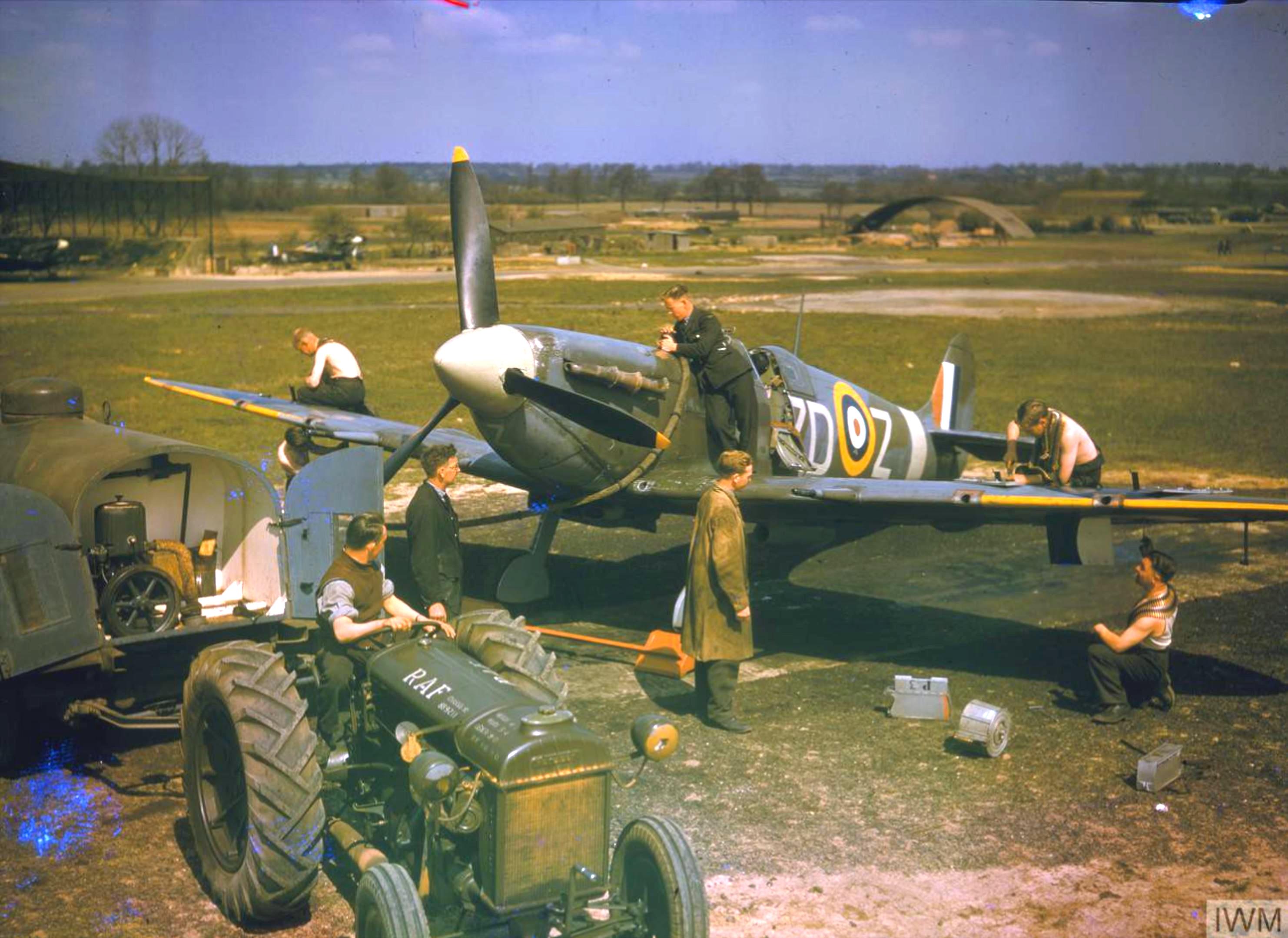 Spitfire MkVb RAF 222Sqn ZDZ being rearmed North Weald Essex May 1942 IWM COL191