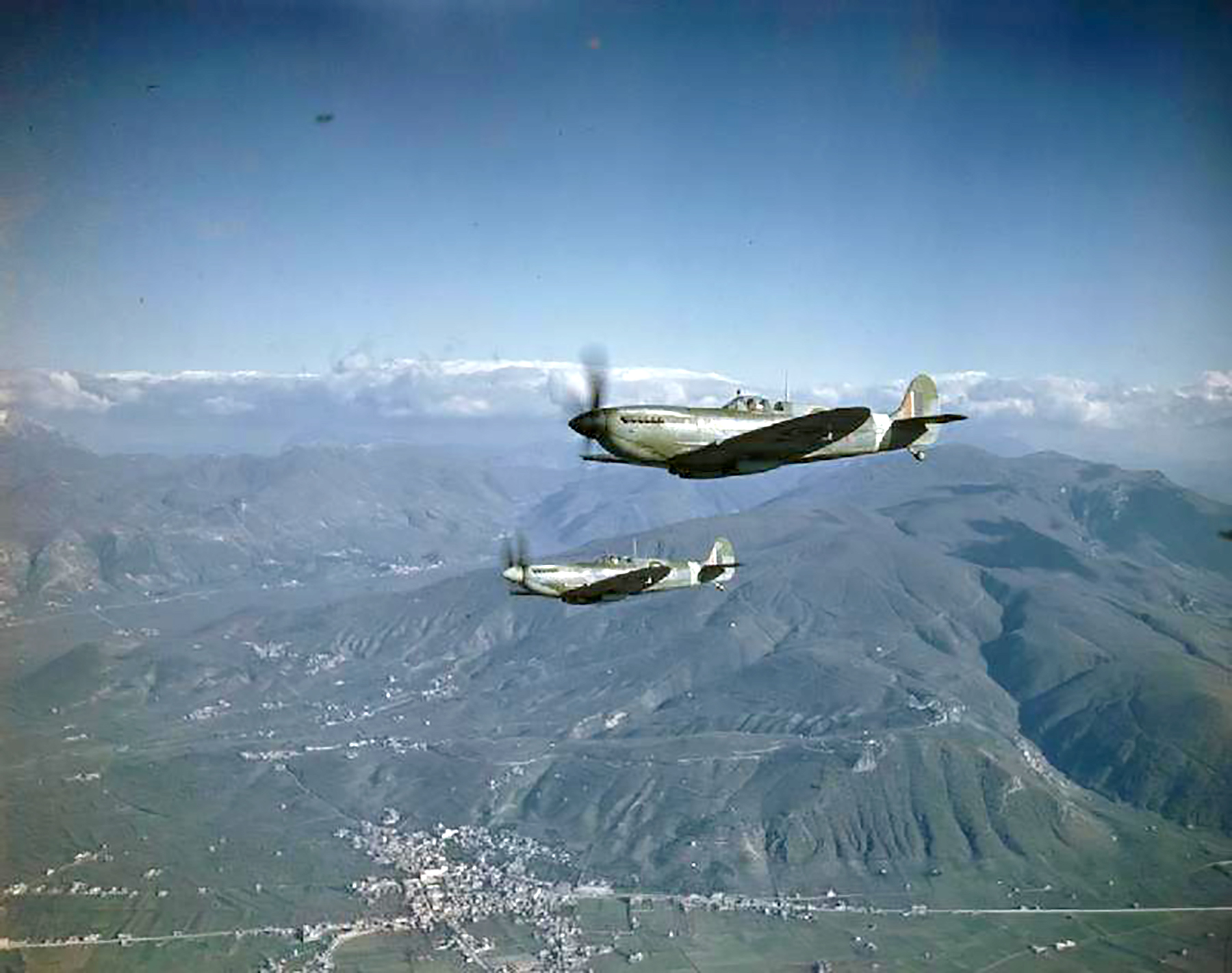 Spitfire MkIXs RAF 241Sqn RZR H Cogman MA425 RZ U JV Macdonald MH635 over Rome IWM 02