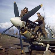Asisbiz Spitfire MkIX RAF 241Sqn ground crew Jim Birkett Wally Passmore working on a Merlin engine IWM 02