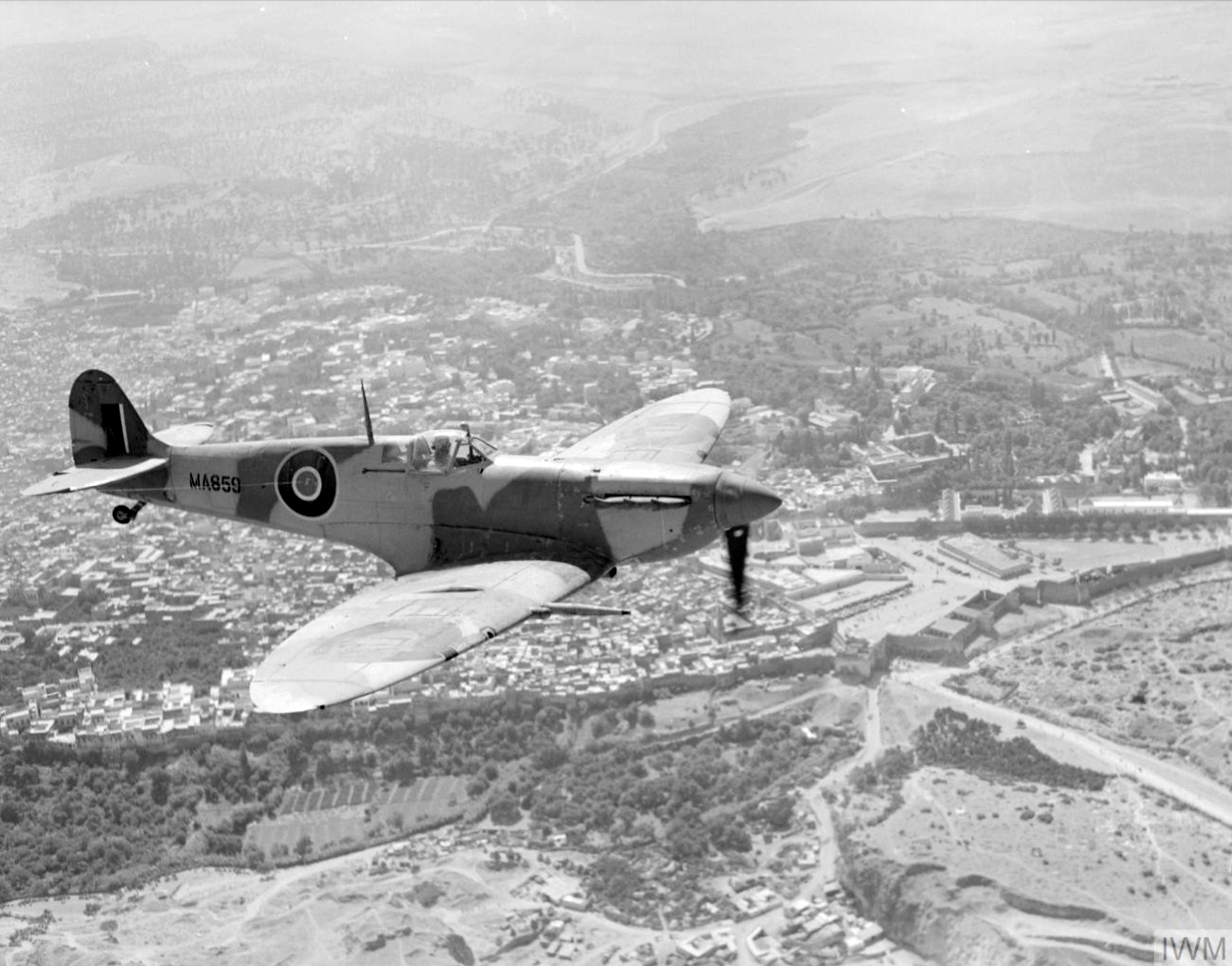 Spitfire MkVc RAF 243Sqn MA859 over Fez Morocco while on its delivery flight IWM CNA2220