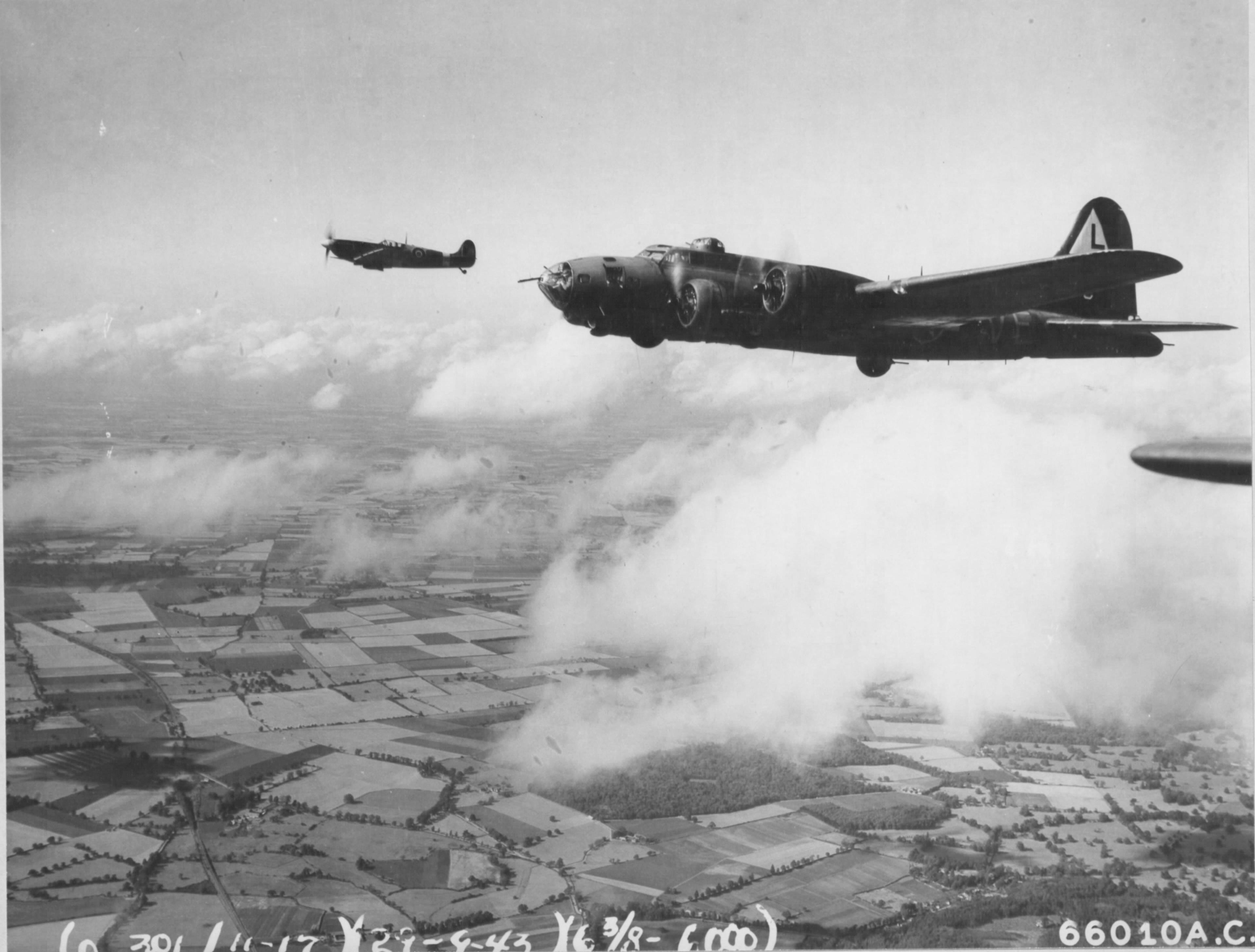 Spitfire MkIX RAF 302Sqn WXR MH869 escorts 8AF B 17 Fortress over France early 1944 01