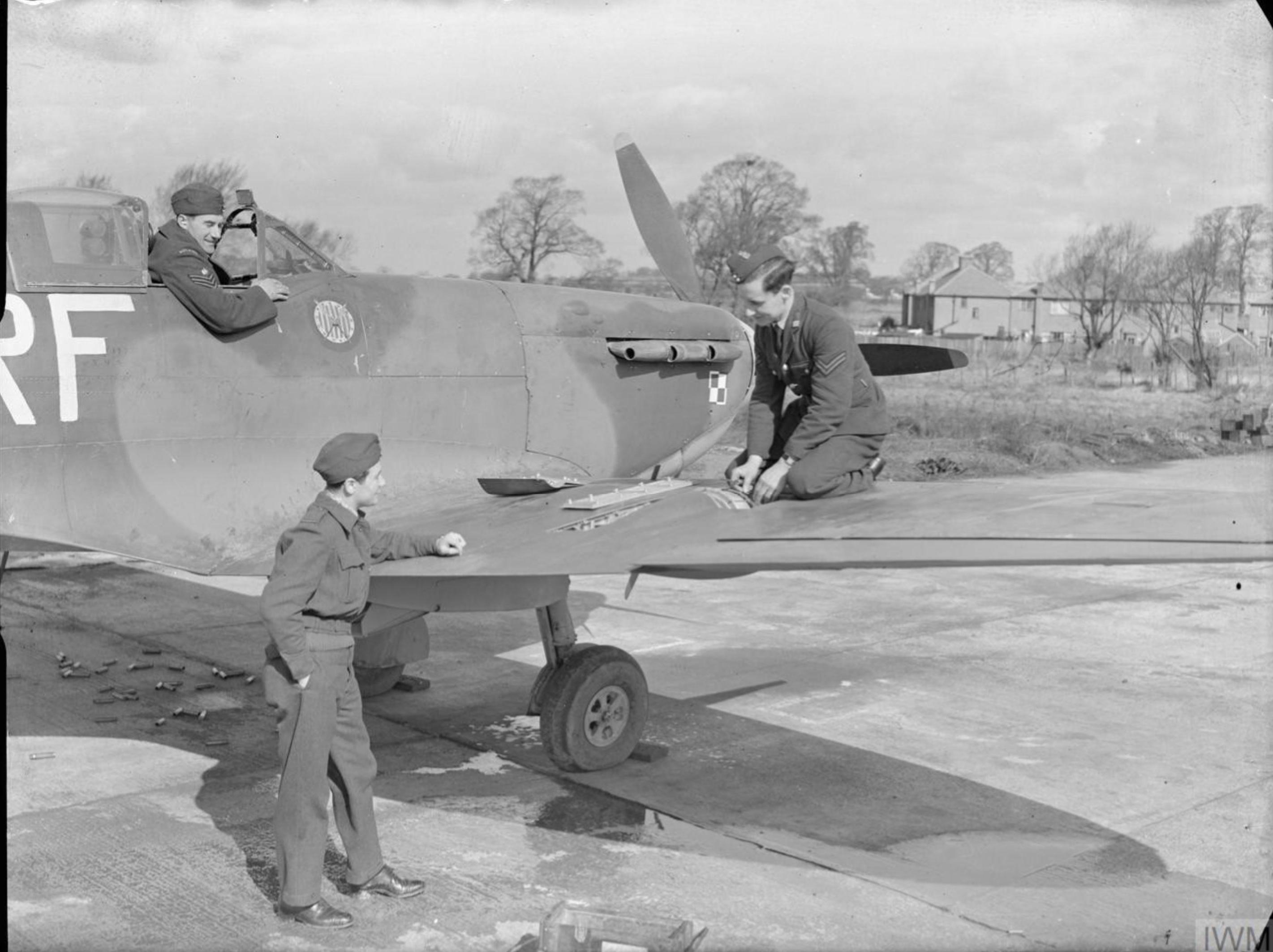 Spitfire MkVb RAF 303Sqn being rearmed at RAF Northolt IWM CH5506