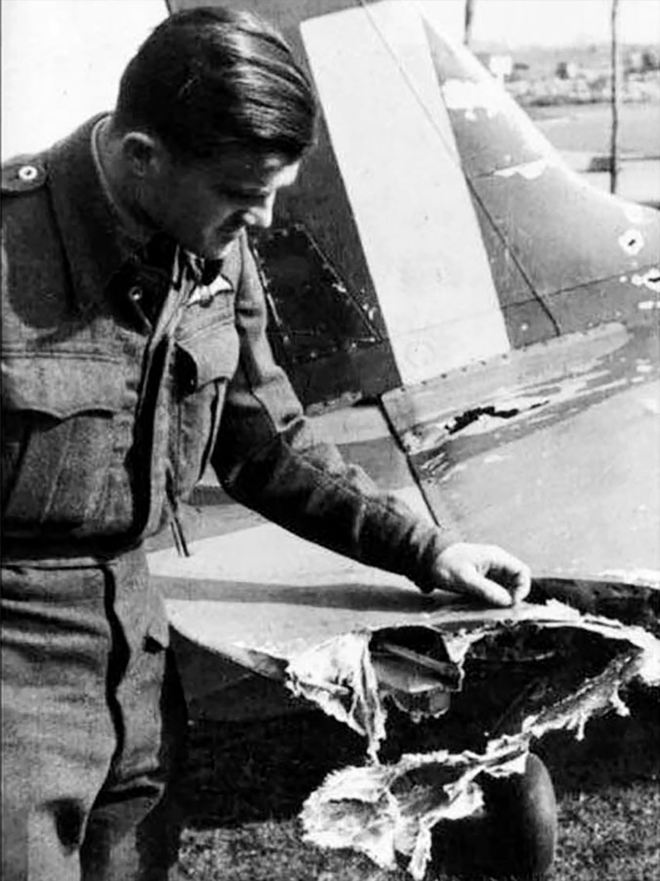 Aircrew RAF 313Sqn Czech pilot FO Vaclav Horak inspects flak damaged over France 1942 01