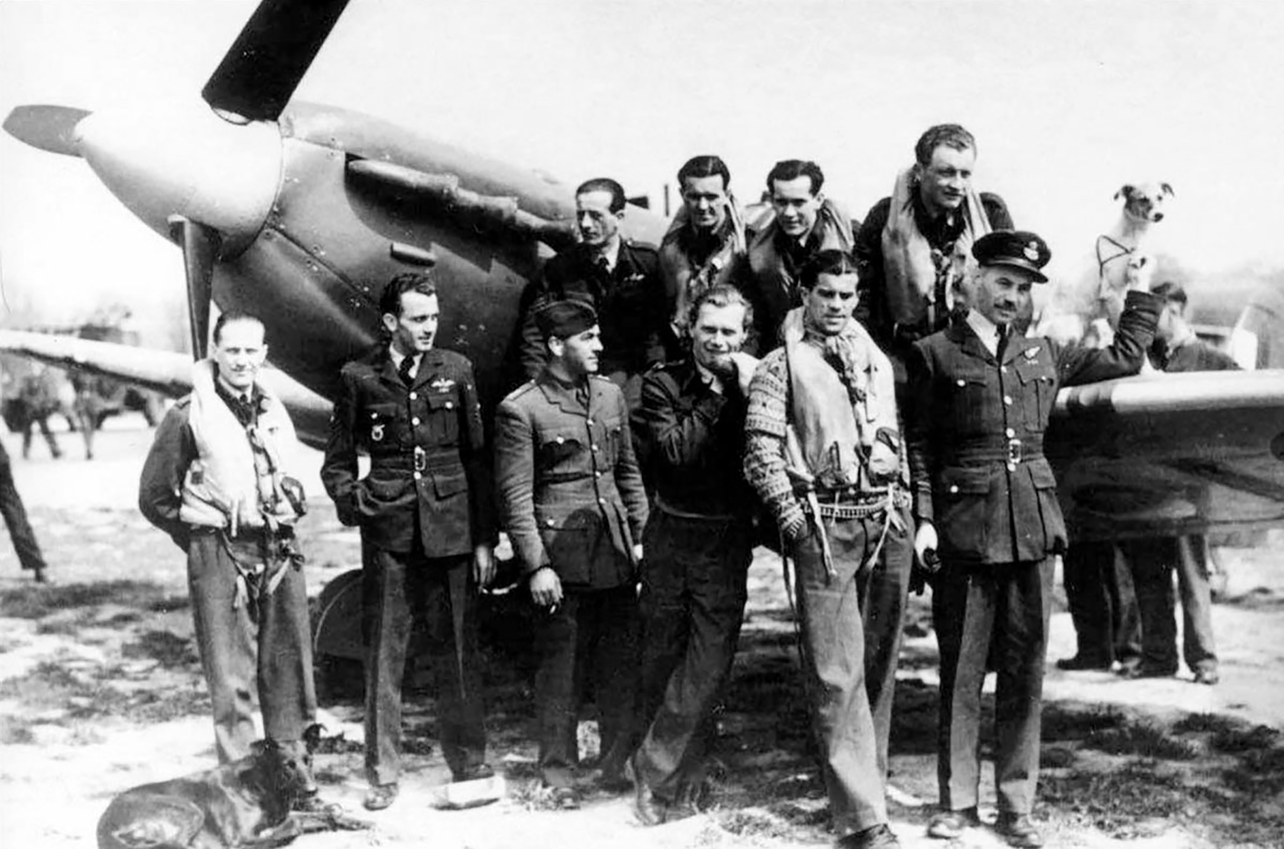 Aircrew RAF 313Sqn Czech pilots pose next to a Spitfire like the jumper Hornchurch Mar 1942 01