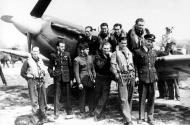 Asisbiz Aircrew RAF 313Sqn Czech pilots pose next to a Spitfire like the jumper Hornchurch Mar 1942 01