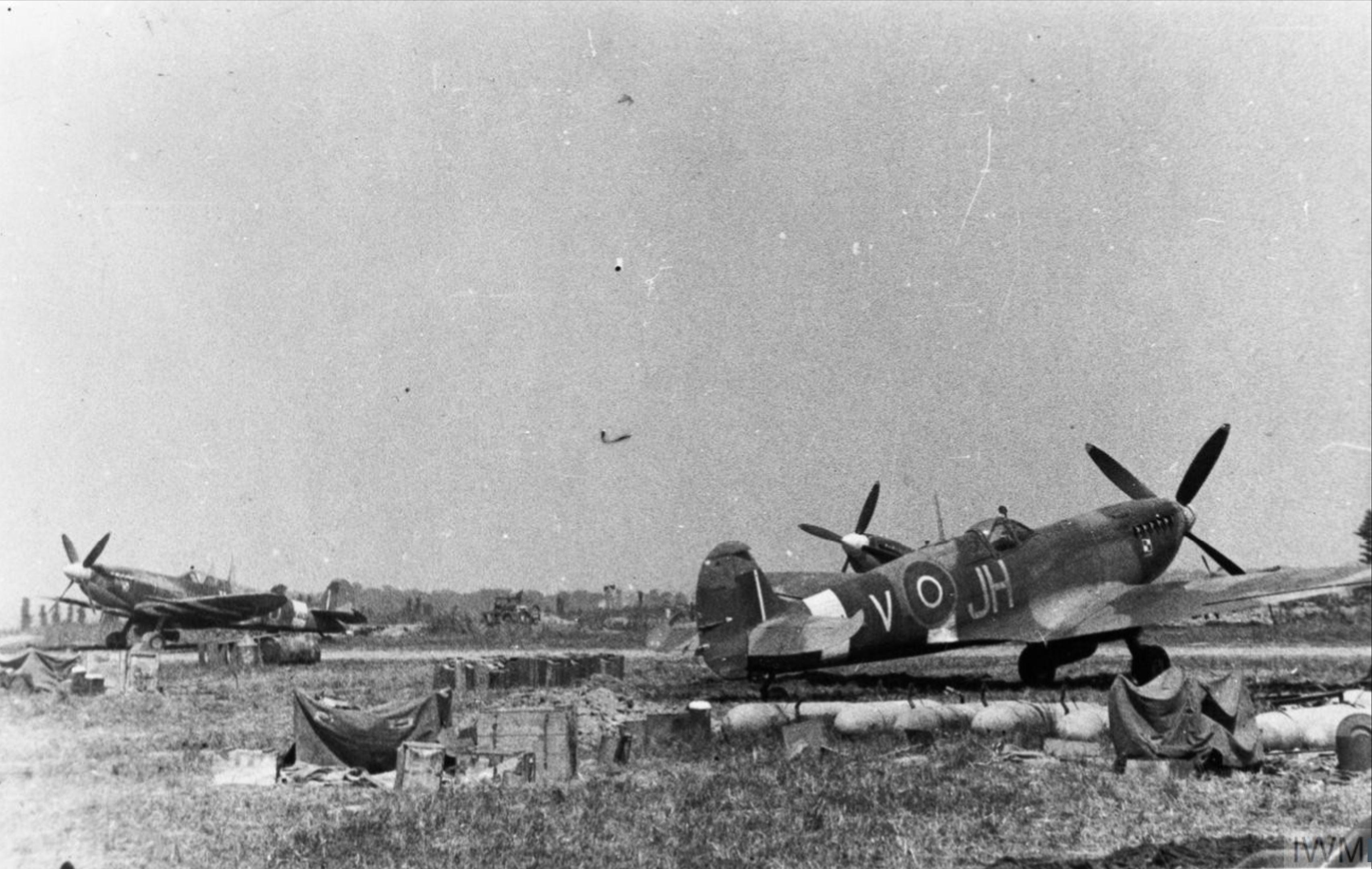 Spitfire MkIXc RAF 317Sqn JHV at B10 Plumetot Aug 1944 IWM MH6852