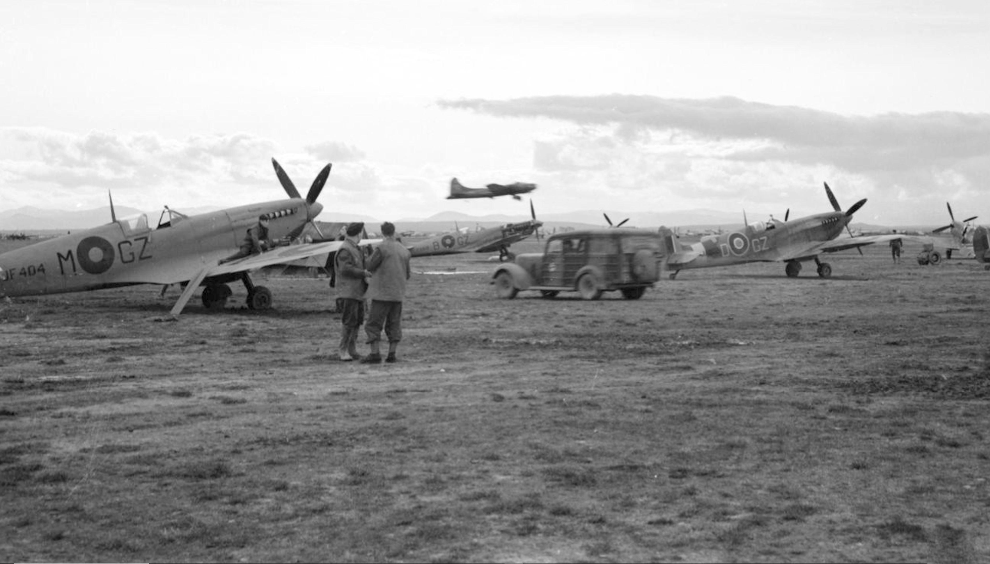 Spitfire MkVIII RAF 32Sqn GZM JF404 and HFIX GZB MA619 GZD at Foggia Italy 1943 IWM CNA2663