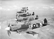 Asisbiz Spitfire FXIIs RAF 41Sqn EBB MB882 EBD MB858 EBH MB794 based at Friston Sussex Apr 1944 IWM CH12754