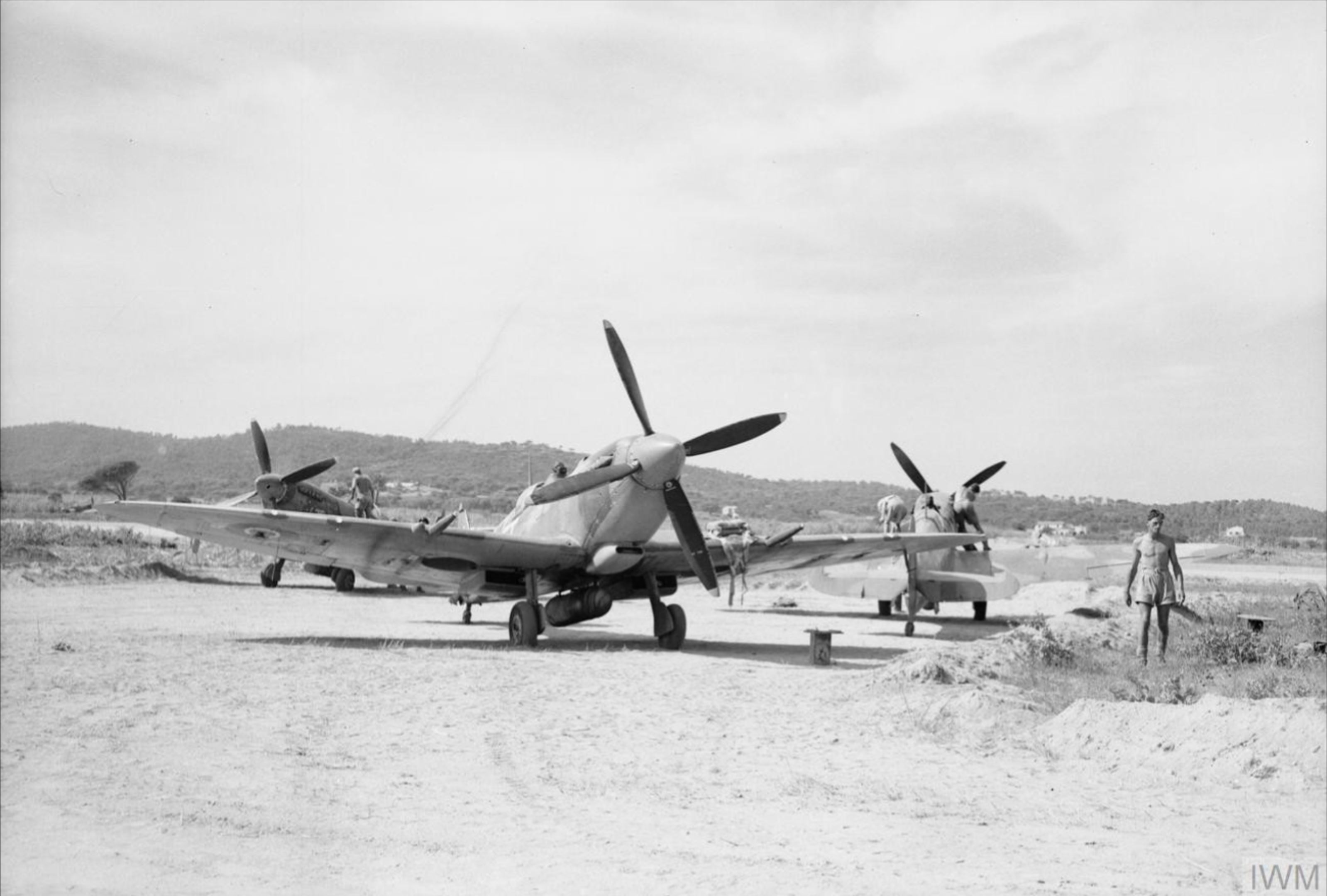 Spitfire MkIXs RAF 43Sqn at dispersal points on Ramatuelle 1944 IWM CL997