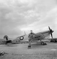 Asisbiz Spitfire MkVcTrop RAF 43Sqn FTZ JK101 with Sqn Ldr M Rook at Jemappes Algeria IWM CNA356