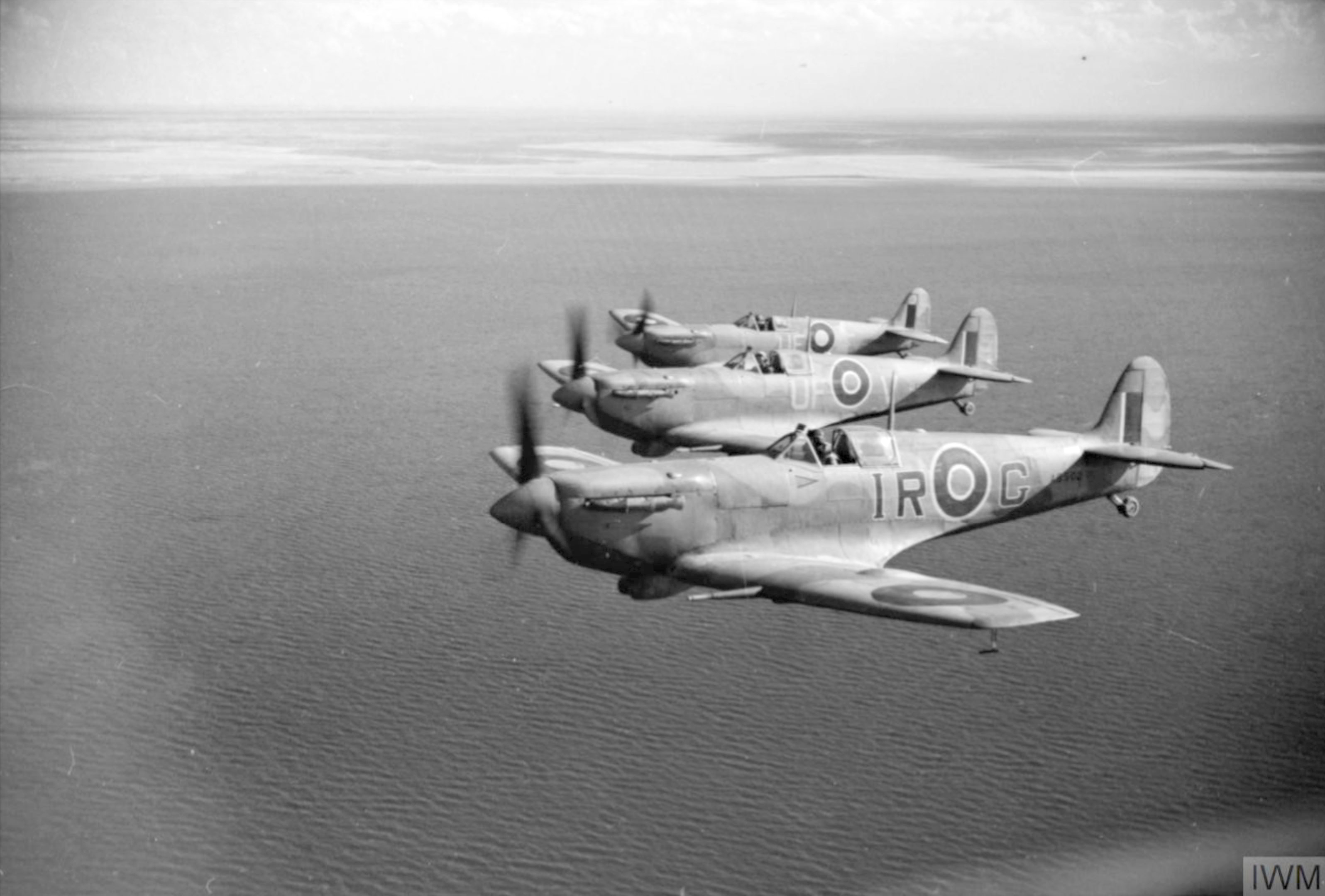 Spitfire LFVb RAF 601Sqn IRG AB502 UFV ER220 UFF EP481 off the Tunisian coast IWM CNA818