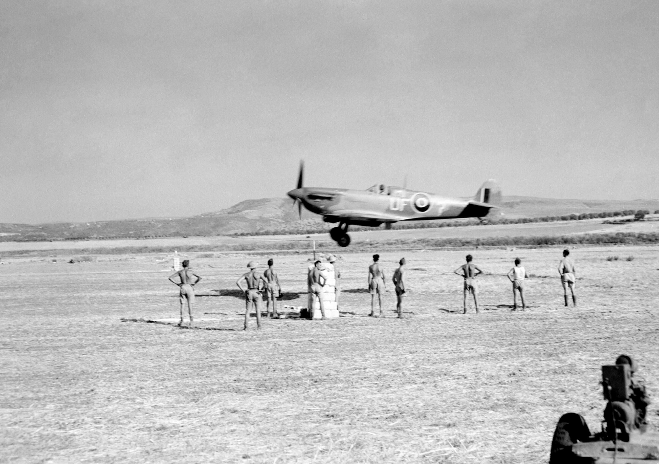 Spitfire MkIX RAF 601Sqn UF Question landing at Lentini West Sicily IWM CNA1099