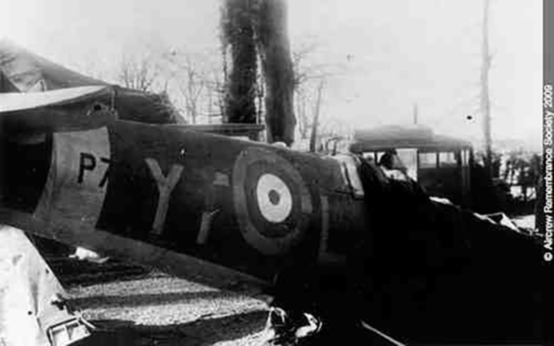 Aircraft wreck of P7665 YTL seen here lying in a French scrapyard 01