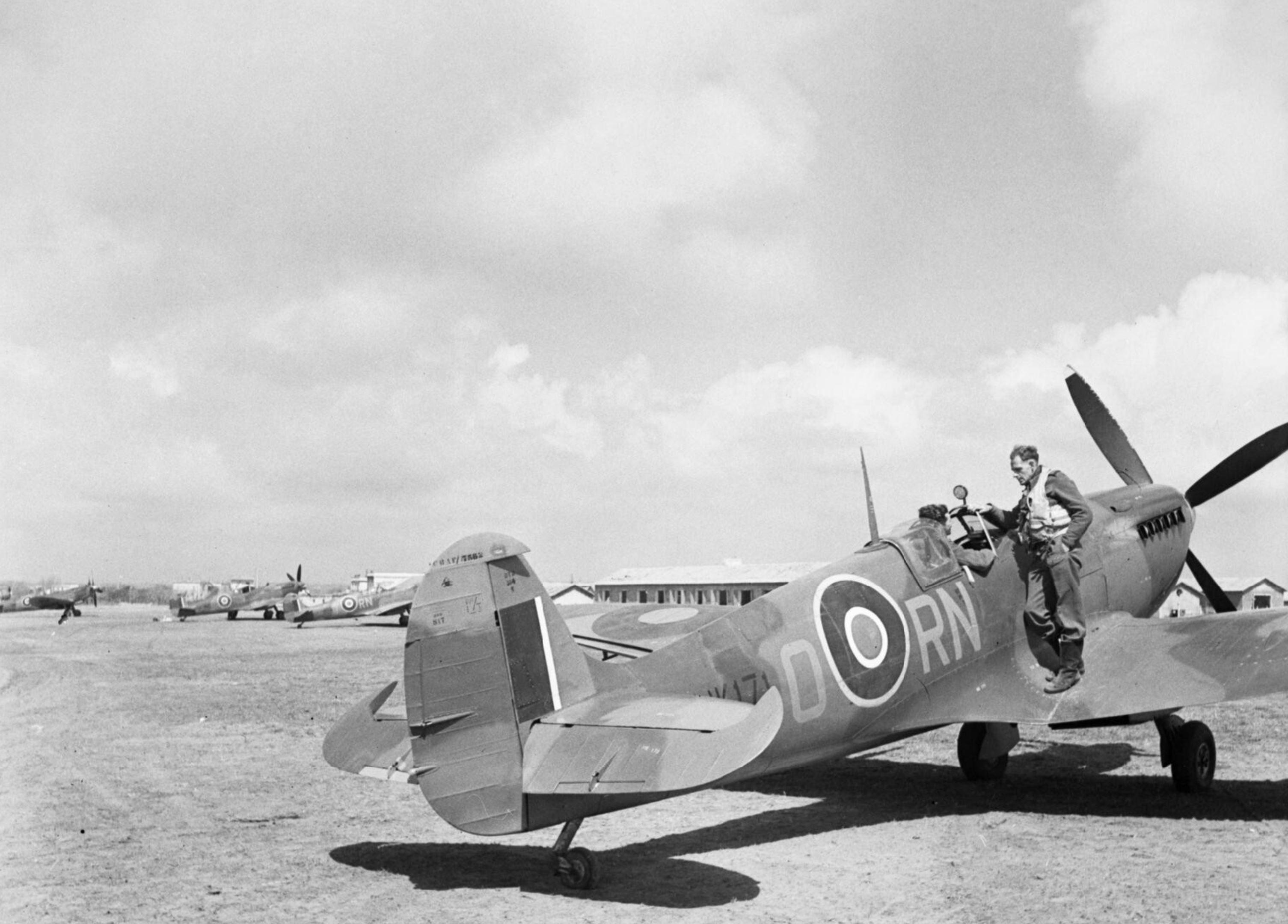 Spitfire MkVc RAF 72Sqn RNO JK171 taking off at Anzio Italy IWM NA14065a