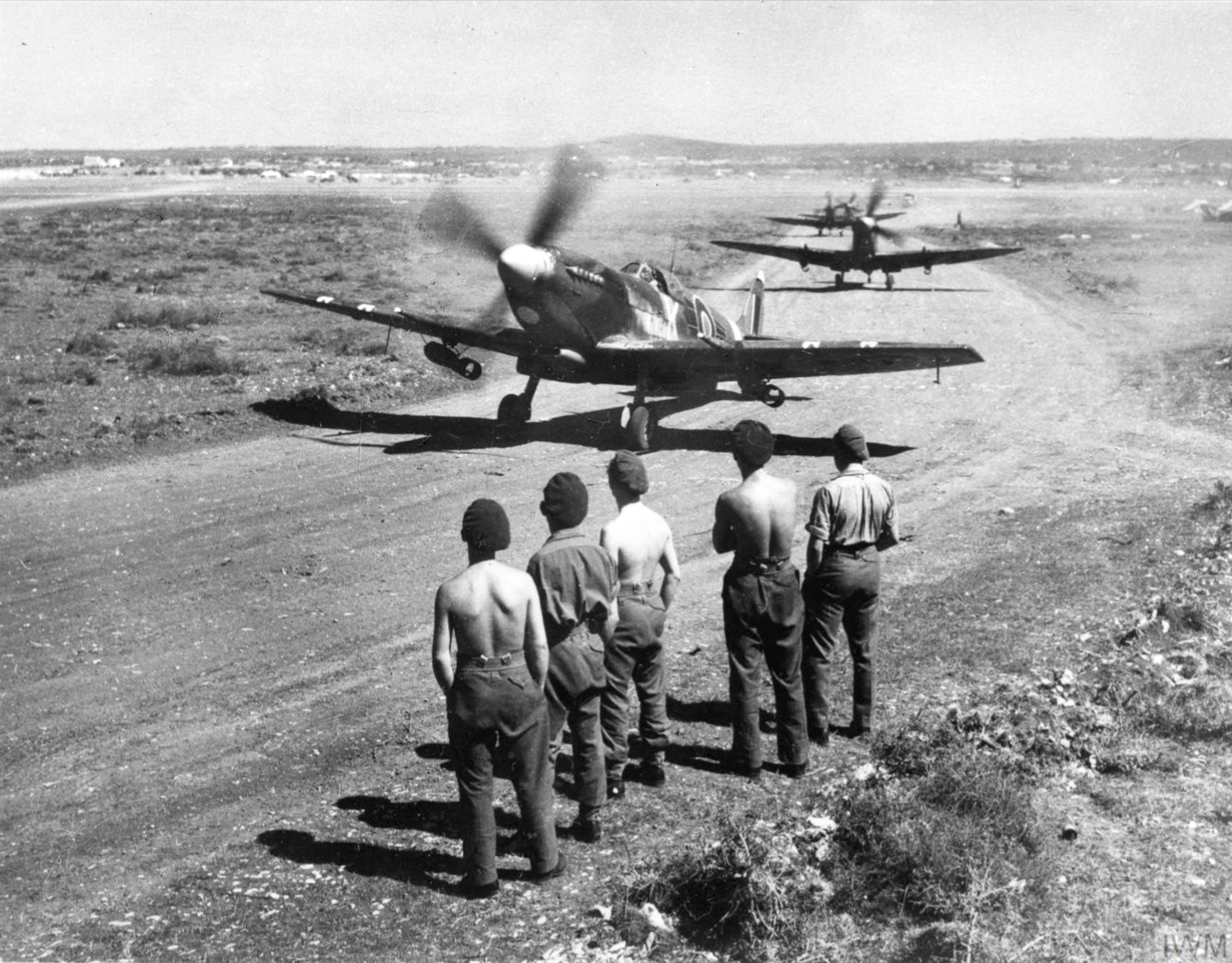 Spitfire MkIXs RAF 73Sqn taxing at Prkos near Zadar Yugoslavia 22nd April 1945 IWM CNA3525
