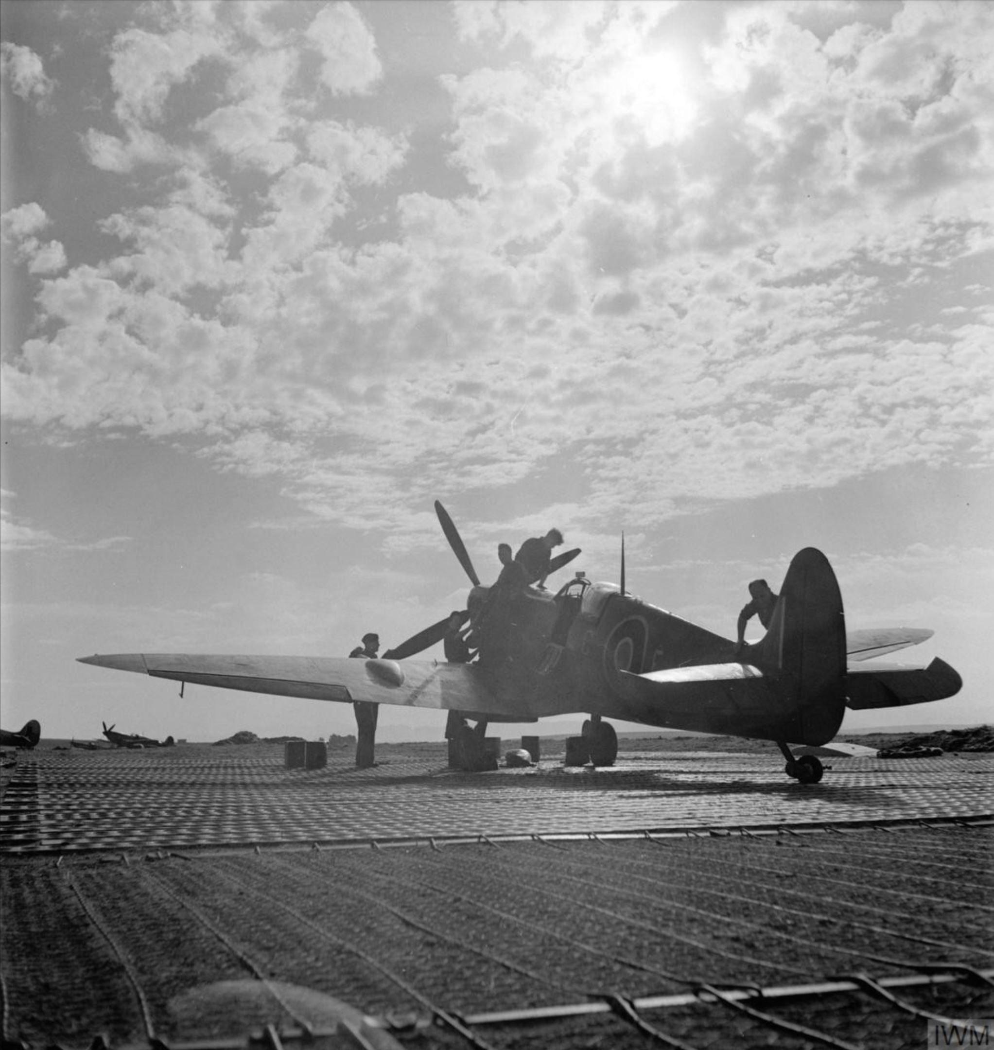 Spitfire MkIX RAF 81Sqn undergoing servicing at Tingley Algeria IWM CNA3836