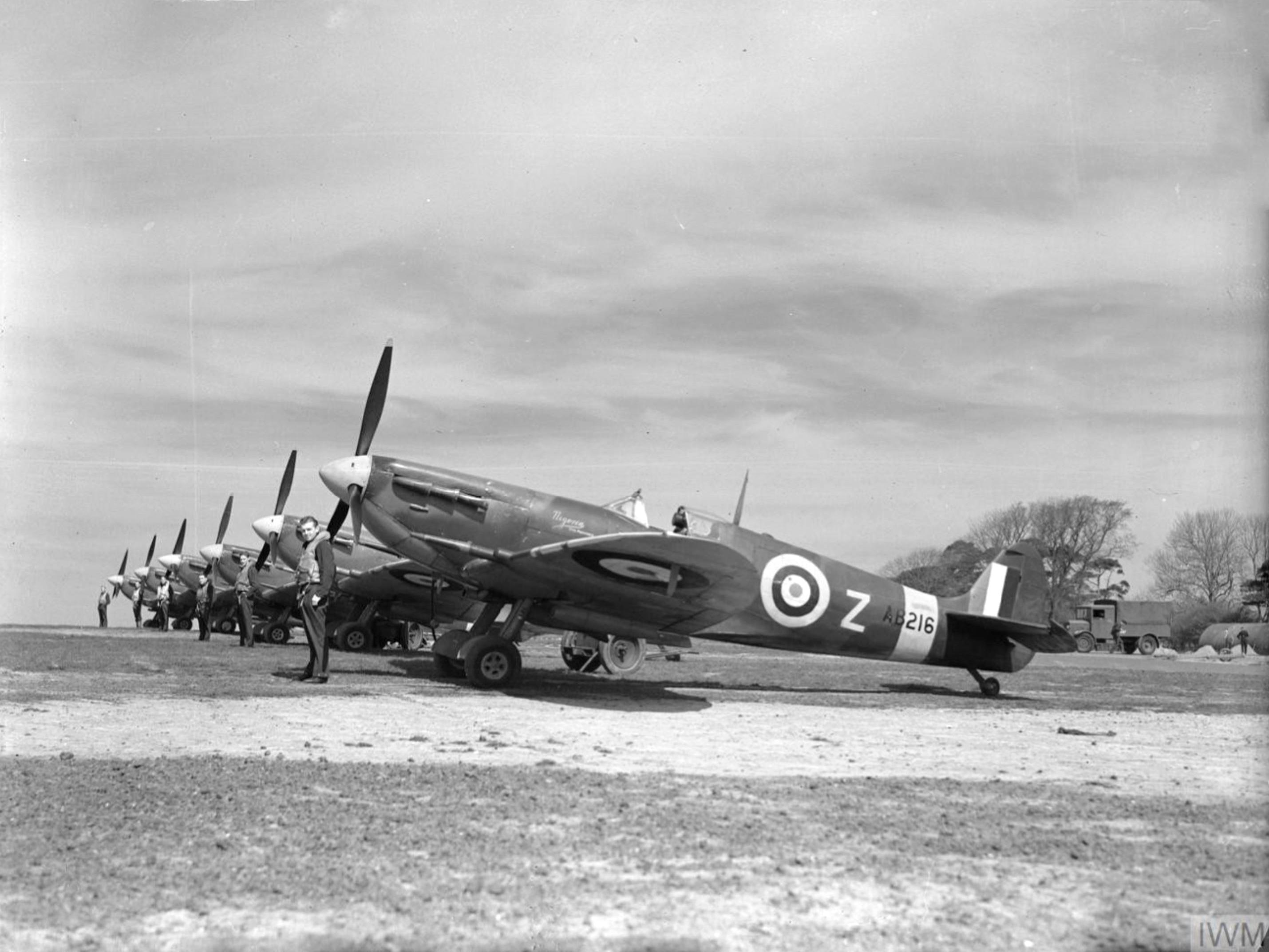 Spitfire MkVc RAF 91Sqn DLZ AB216 lined up at Hawkinge May 1942 IWM CH5429