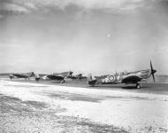 Asisbiz Spitfire MkIXe RCAF 412Sqn VZW taxing at B108 Rheine Germany 1945 IWM MH6849