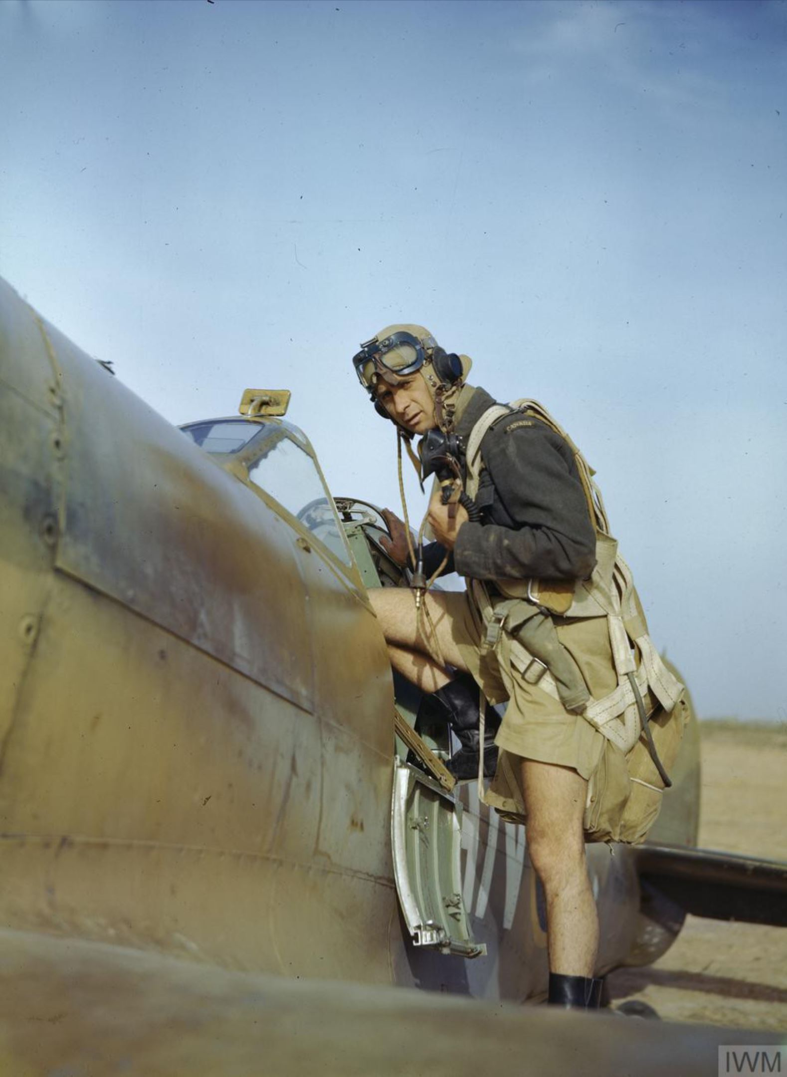 Aircrew RCAF 417Sqn pilot about to embark on a mission Goubrine Tunisia April 1943 IWM TR832