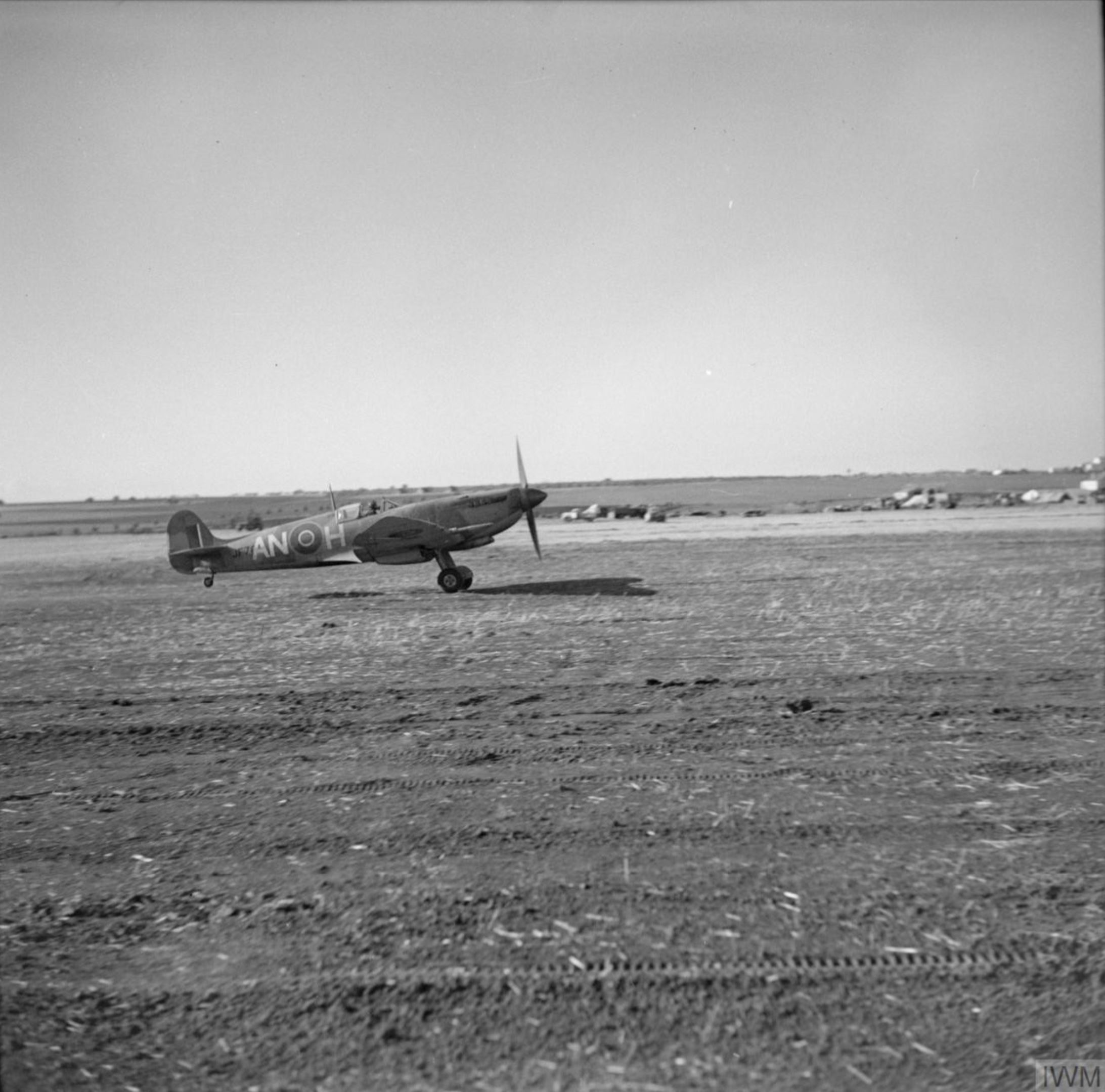 Spitfire MkVII c wing RCAF 417 ANH JF703 taking off at Canne Italy IWM CNA278