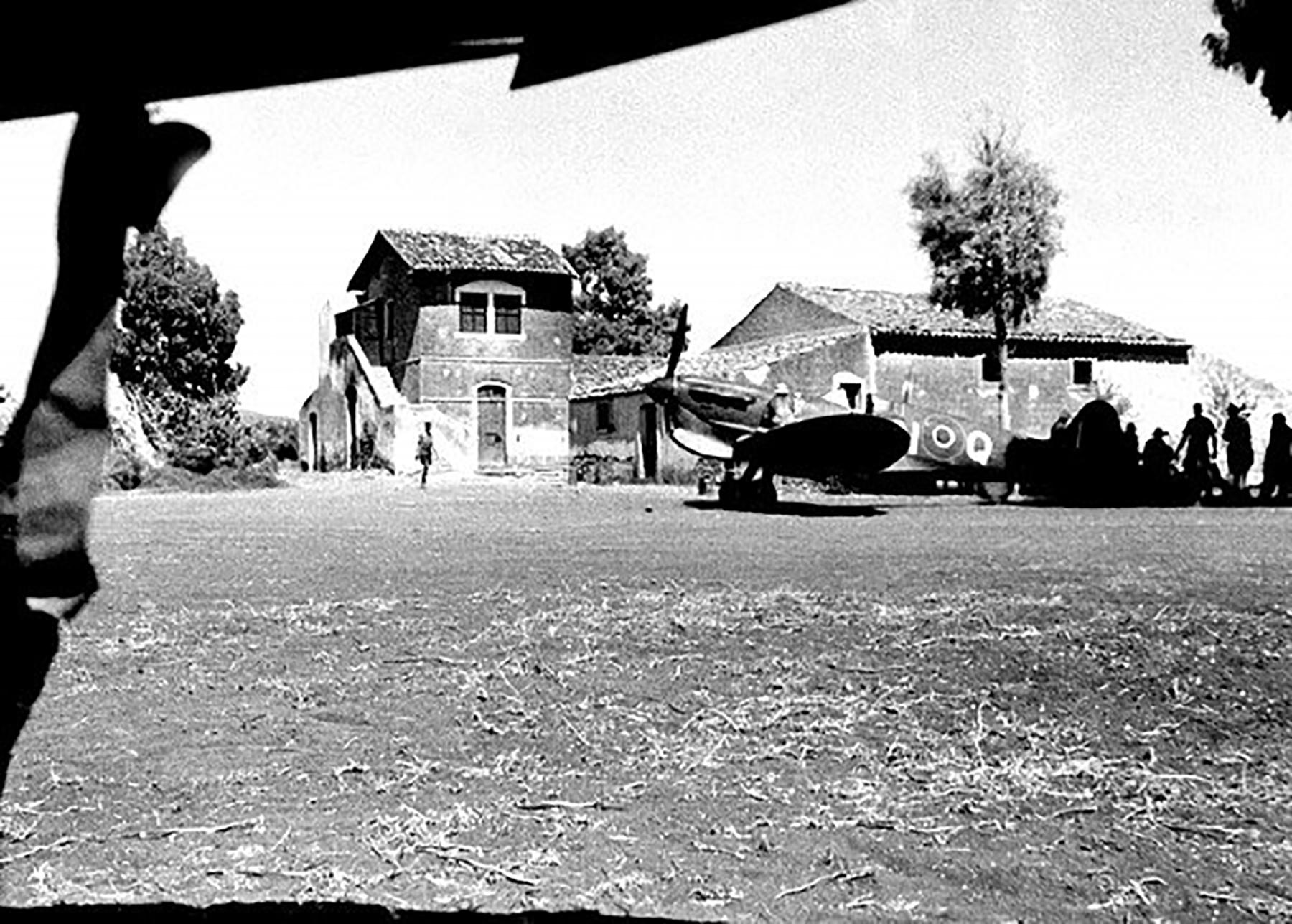 Spitfire MkVcTrop RCAF 417Sqn ANQ an Italian farmhouse used as HQ near Lentini Sicily Aug 26 1943 01