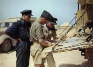 Asisbiz Aircrew RCAF 417Sqn pilots planning another mission Goubrine airfield Tunisia April 1943 IWM TR829