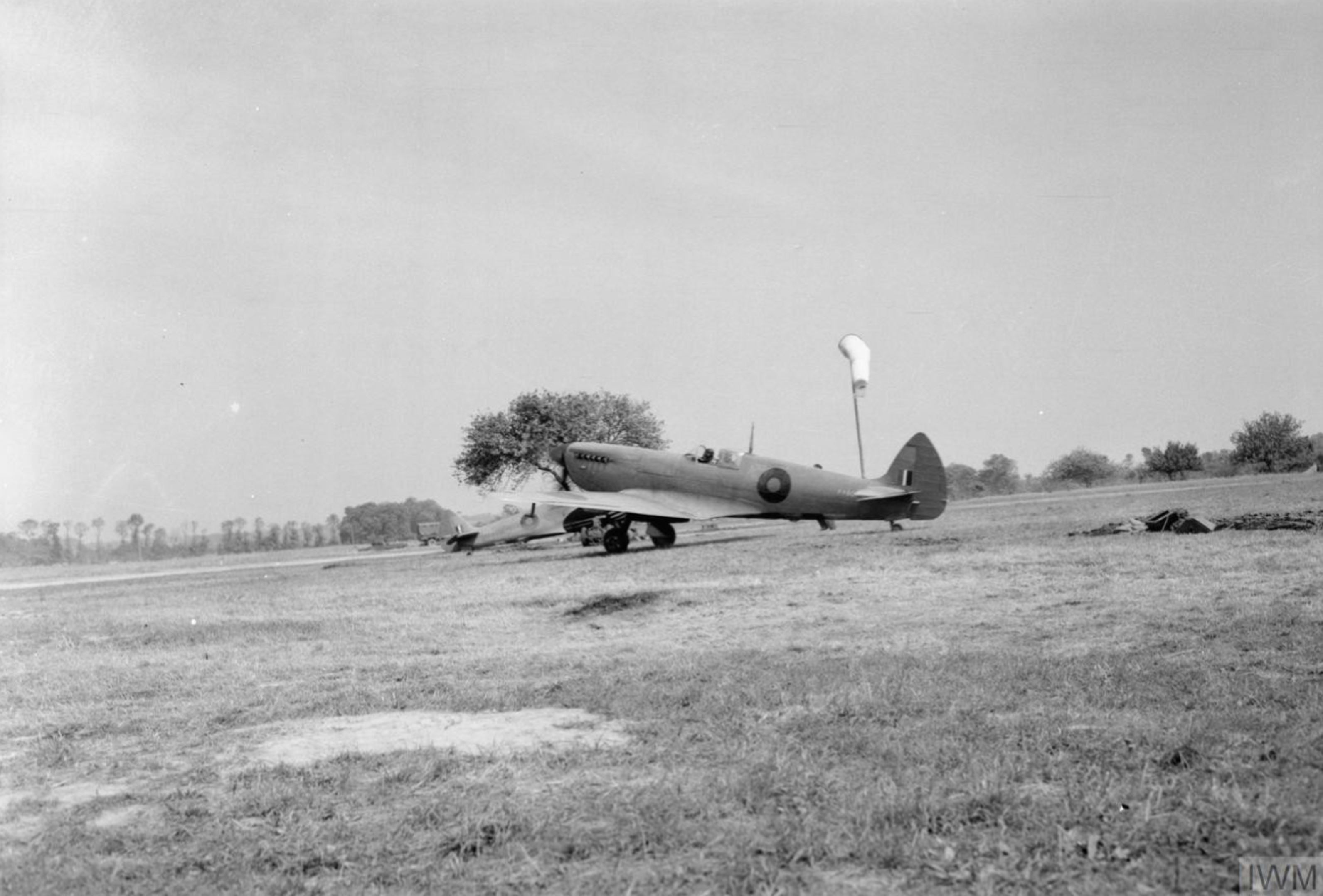 Spitfire MkIXs RCAF 400Sqn at B21 Ste Honorine de Ducy Normandy 1944 IWM CL826