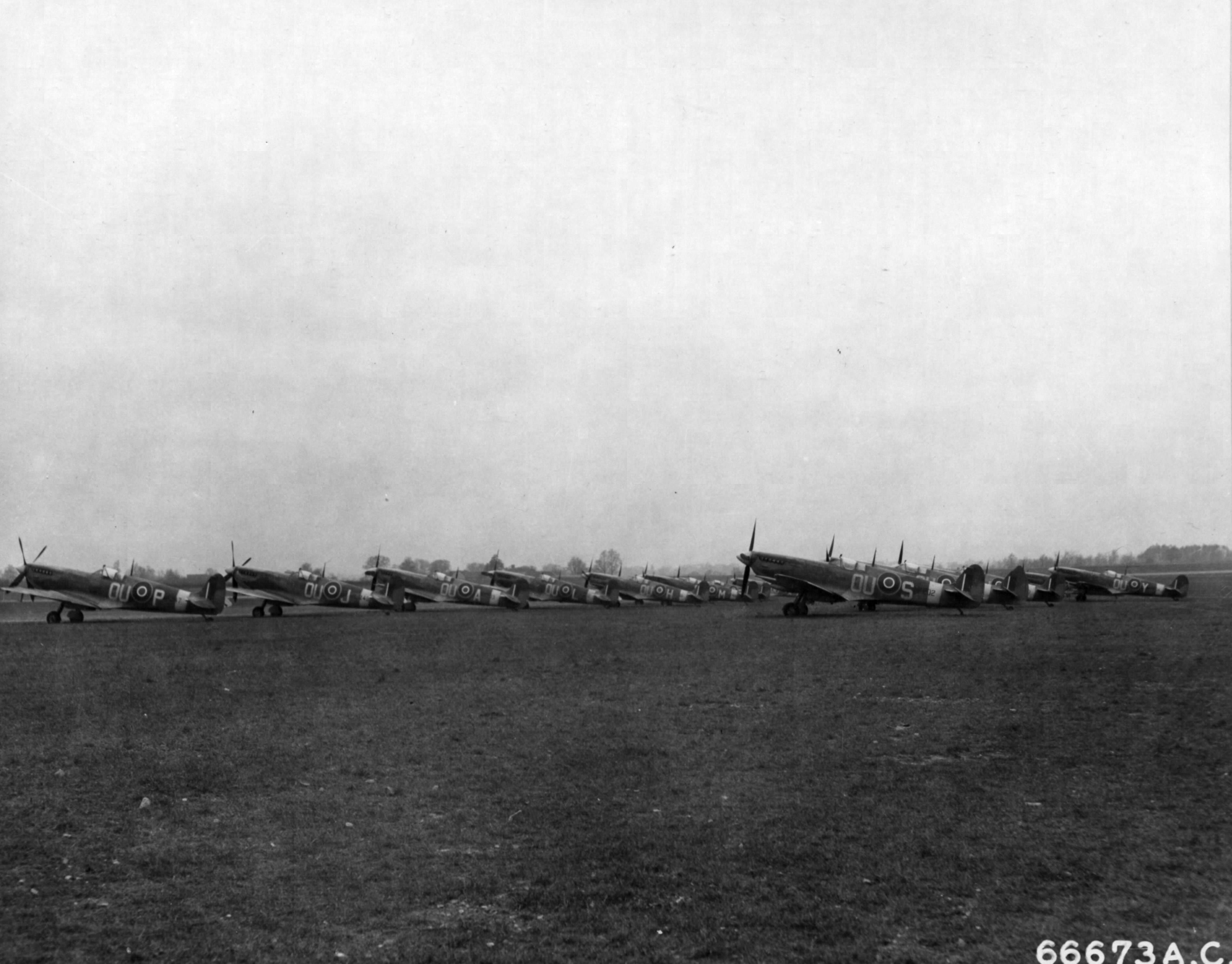 Spitfires LFIX RNZAF 485Sqn OUS OUY OUP OUJ OUA OUL OUH and OUM at RAF Station 112 England 30th Mar 1944 01