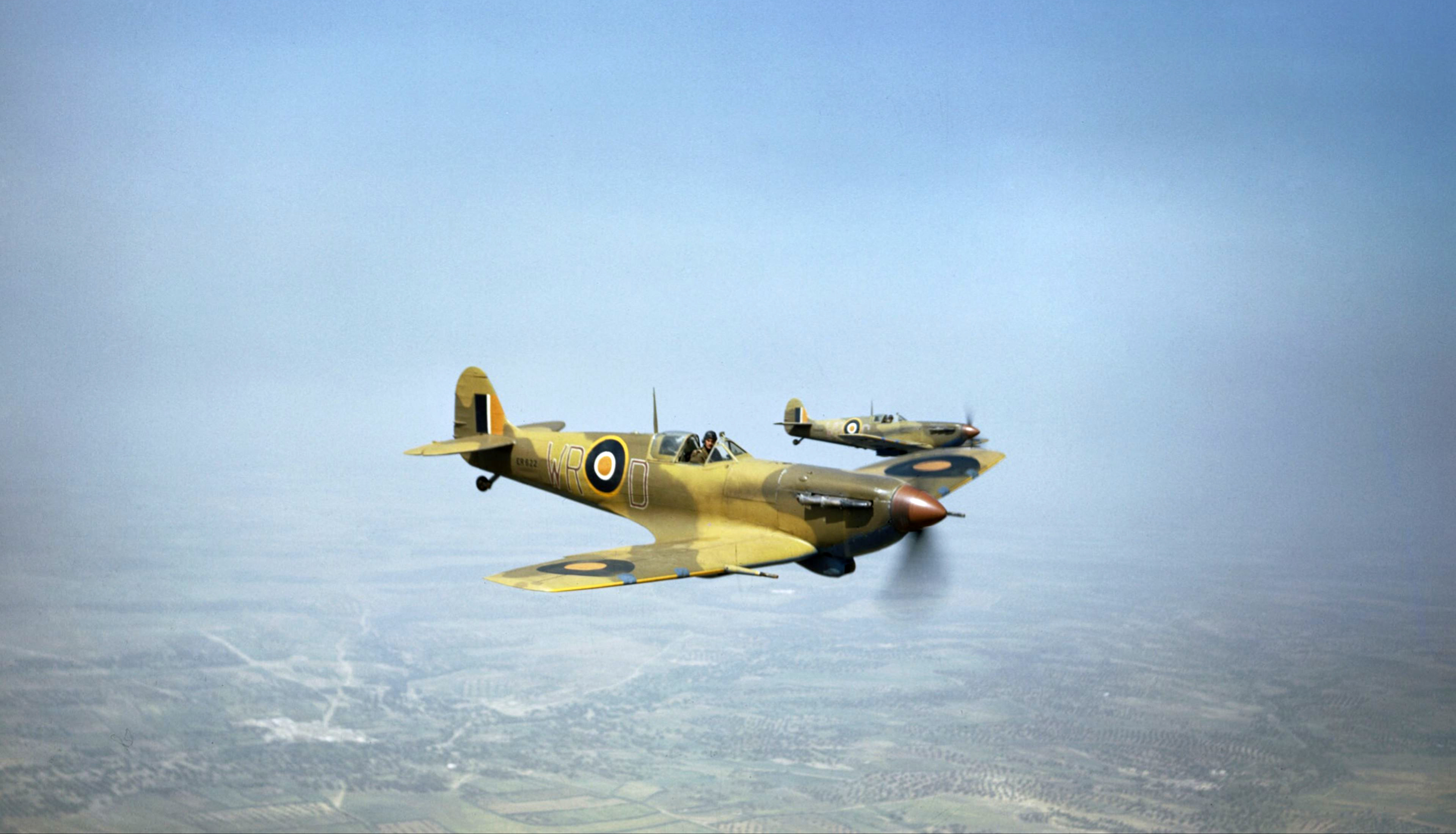 Spitfire LFVb SAAF 40Sqn WRD ER622 and WRC supporting ground forces Tunisia IWM TR1019a