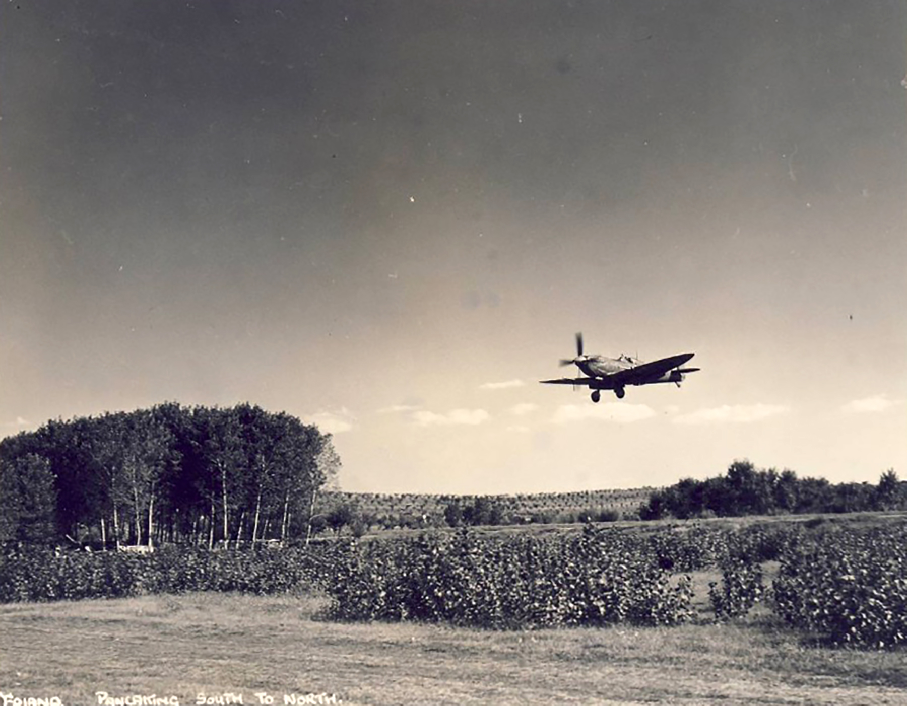 Spitfire MkVII c wing landing at a base in Italy 01