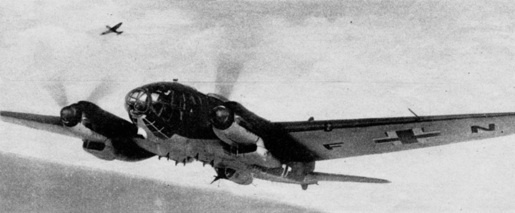 Camera battle footage between Luftwaffe He 111H bombers and a RAF Spitfire off the coast Spring 1941 01