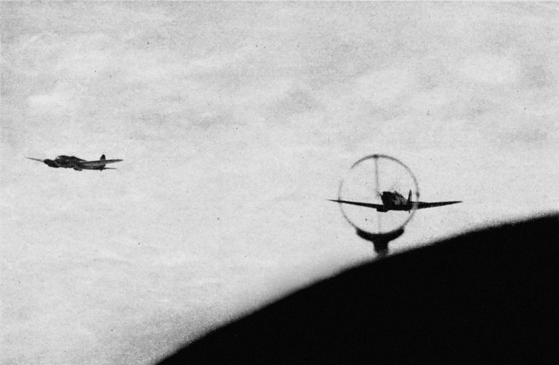 Camera battle footage between Luftwaffe He 111H bombers and a RAF Spitfire off the coast Spring 1941 03