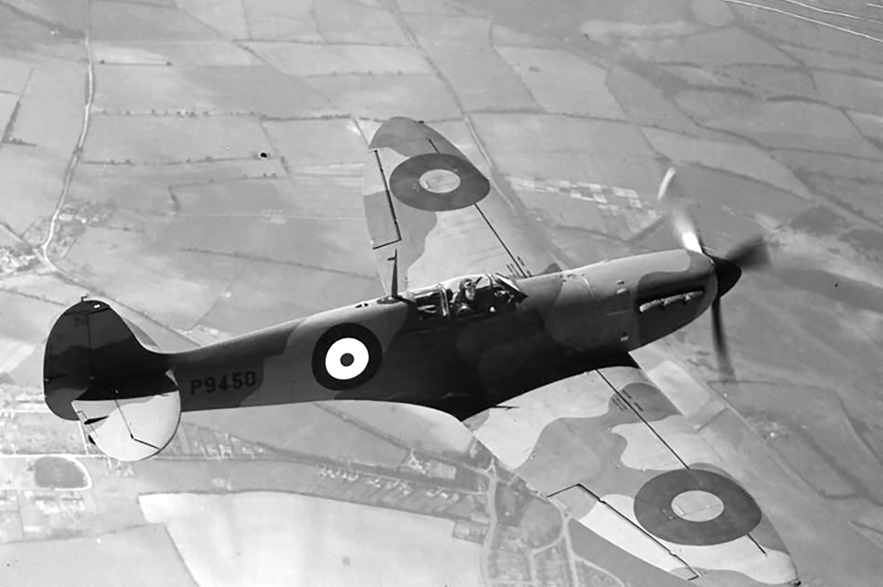 Factory fresh Spitfire MkIa P9450 showing upper wing camouflage in flight April 1940 web 01