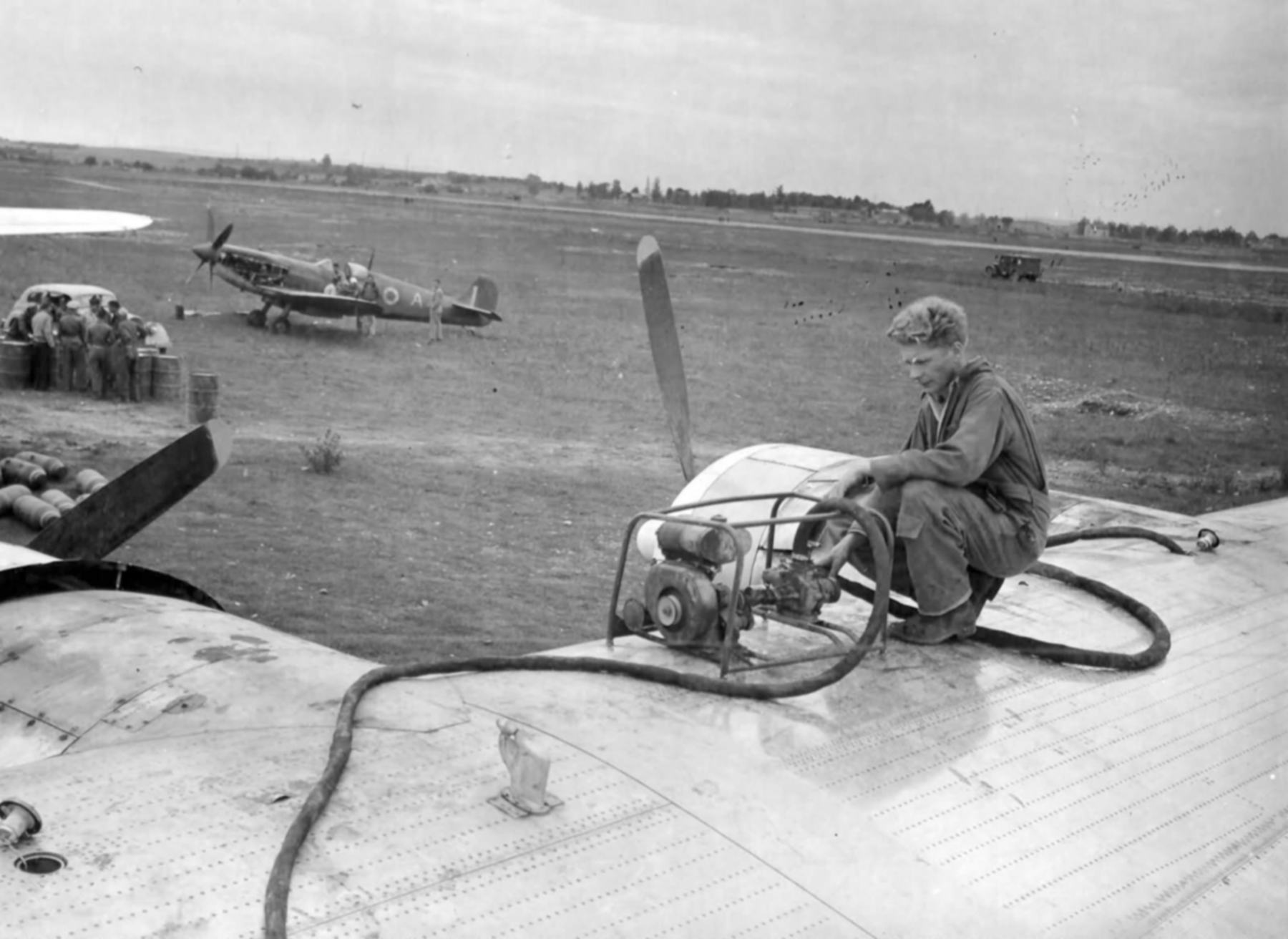 Spitfire MkIX and USAAF B 24 Liberator at a refueling depot in Francelate 1944 web 01