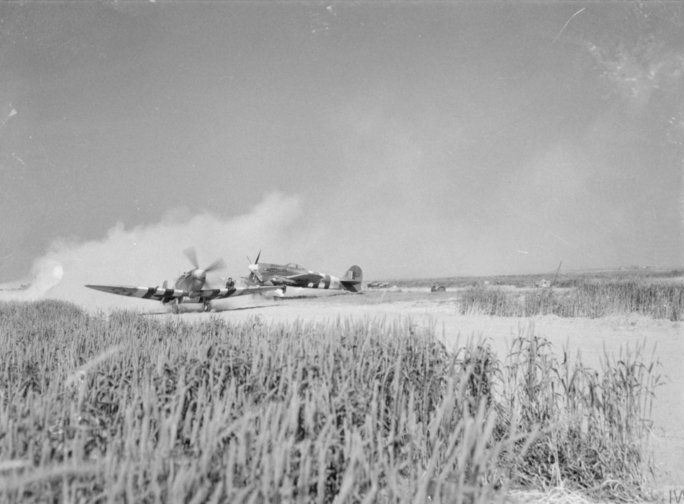 Spitfire MkIX taxing at B2 Bazenville Normandy 1944 IWM CL182