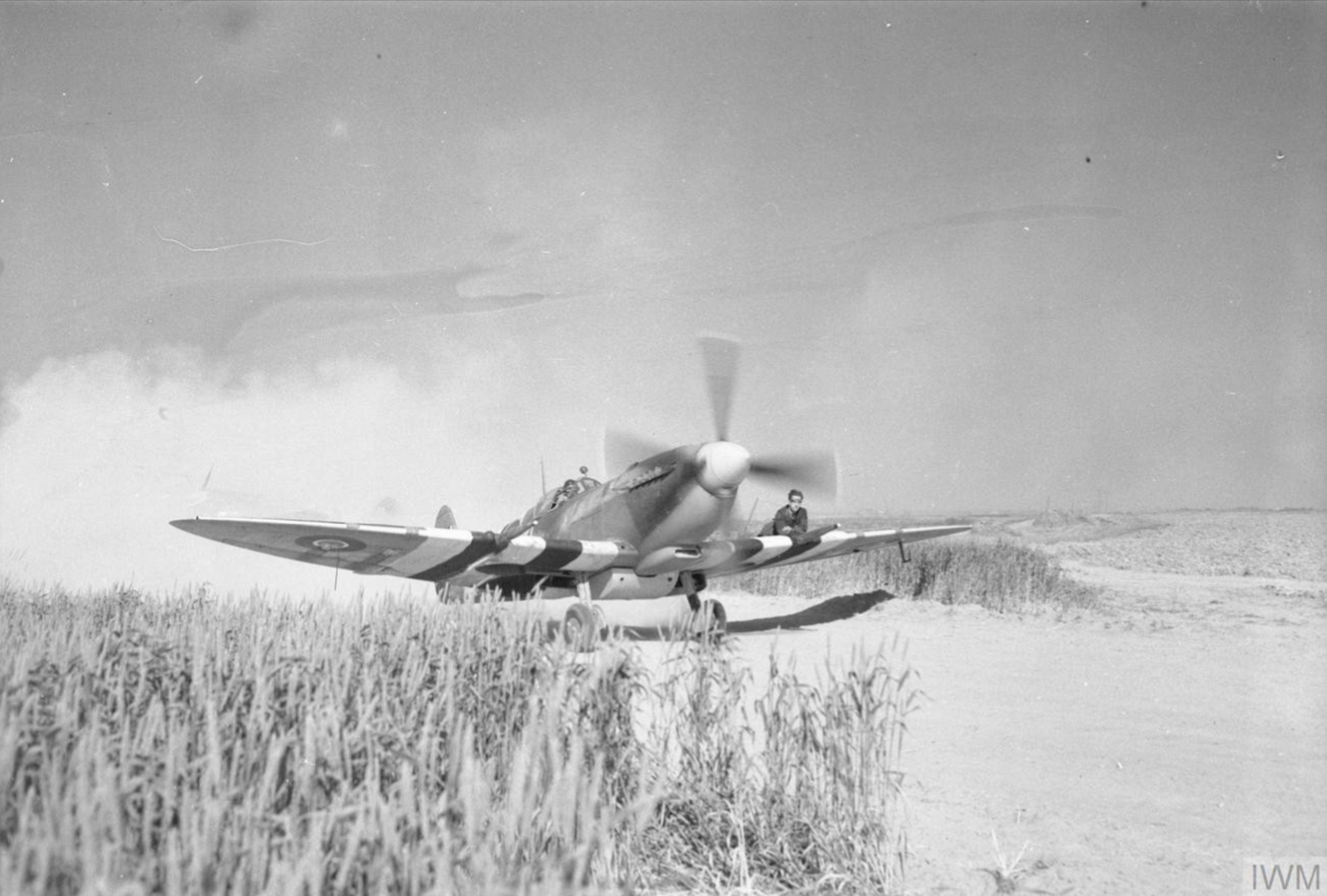 Spitfire MkIX taxing at B2 Bazenville Normandy 1944 IWM CL182A