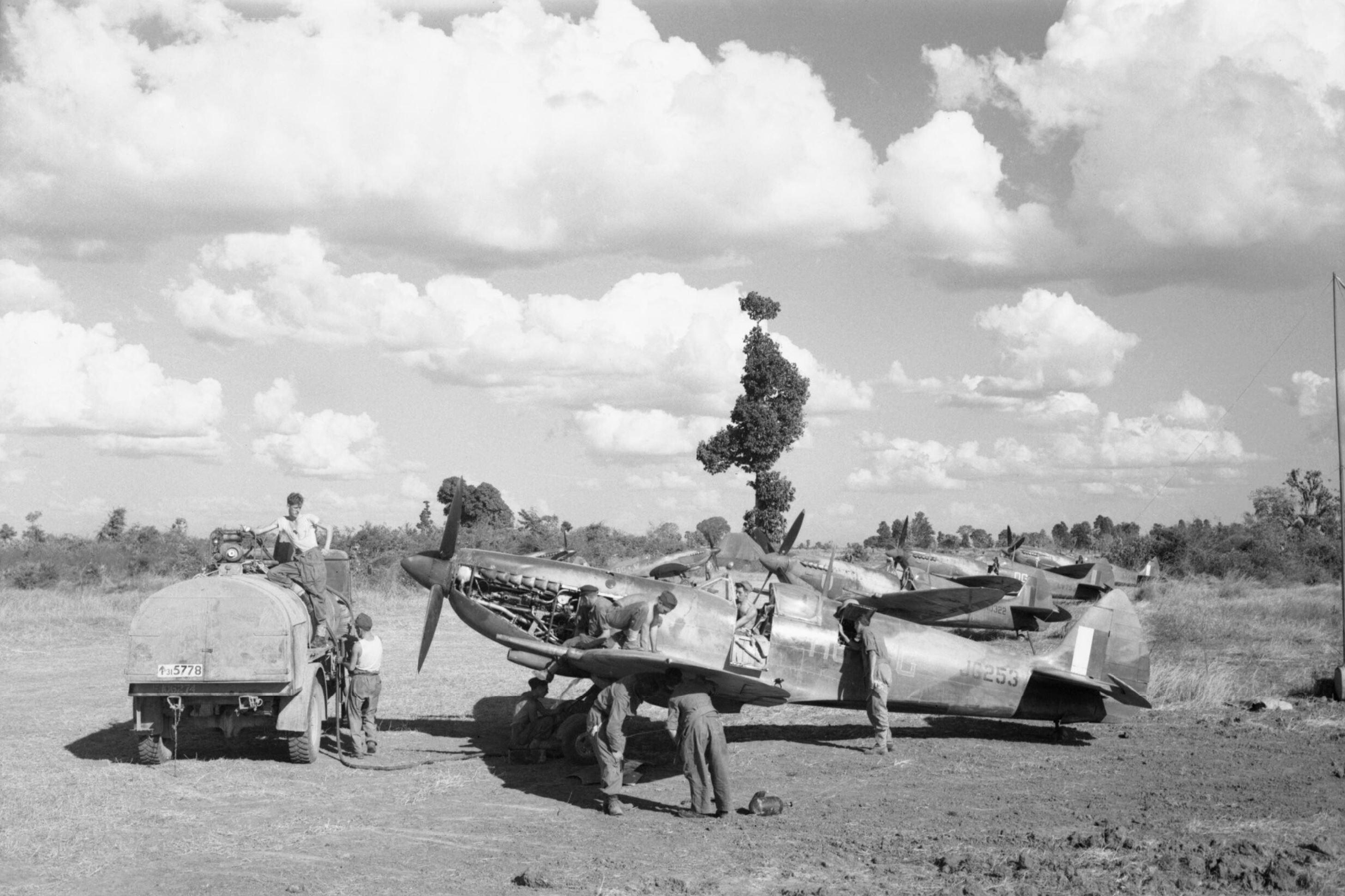 Spitfire MkVIII RAF 155Sqn DGV foreground at Tabingaung 1944 IWM CF269