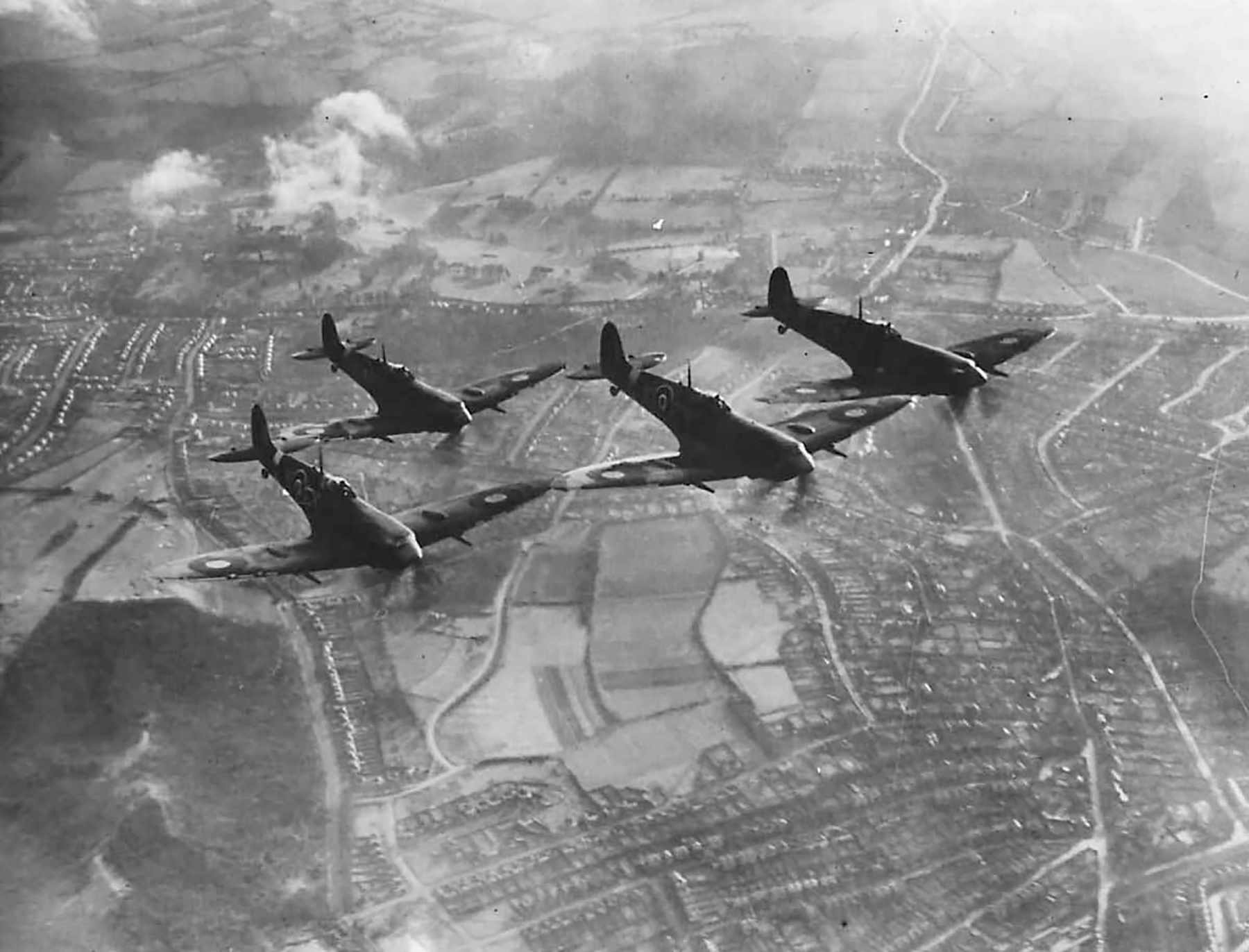 Spitfires over England in tight formation 1942 web 01