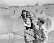 Asisbiz Recon Spitfire PRXI RAF 682Sqn White F with Sqn Ldr JT Morgan at San Severo Italy IWM CNA2966