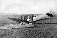 Asisbiz Spitfire MkVb force landed being inspected by DAK soldiers 1943 web 01