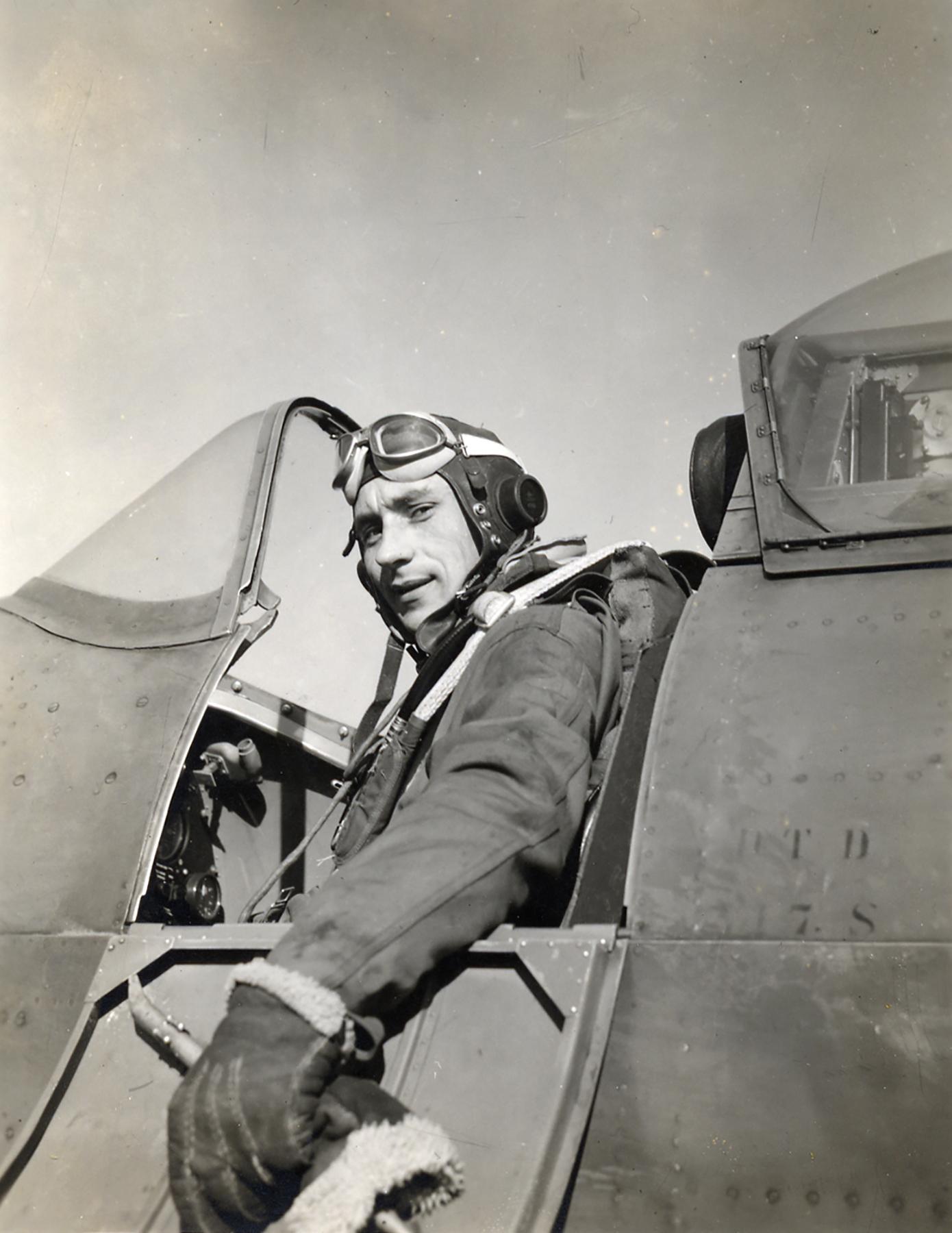 Aircrew USAAF 7PRG pilot Lt Charles JJ Goffin in Spitfire MkXI cockpit 01
