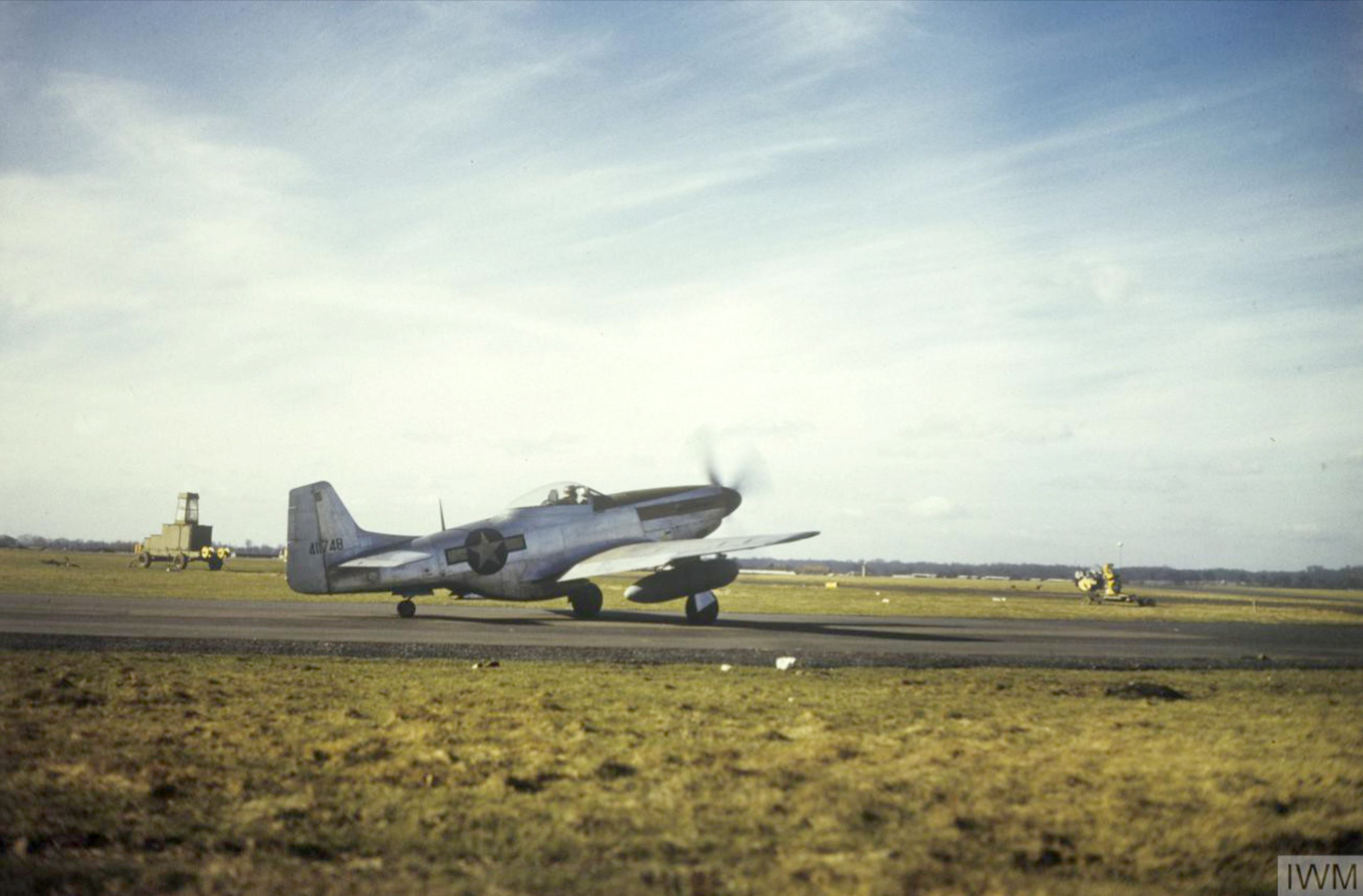 P 51D Mustang USAAF 41 1748 7PG13PS taking off Mount Farm IWM FRE5388