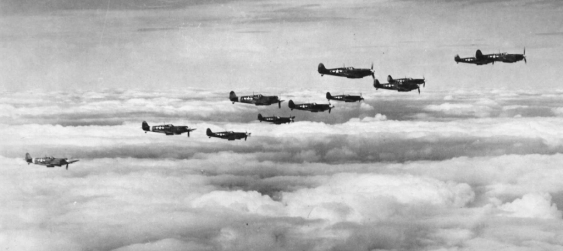 Spitfire MkVb USAAF 67TRG12TRS in formation over England 03