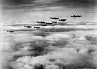 Asisbiz Spitfire MkVb USAAF 67TRG12TRS in formation over England 01