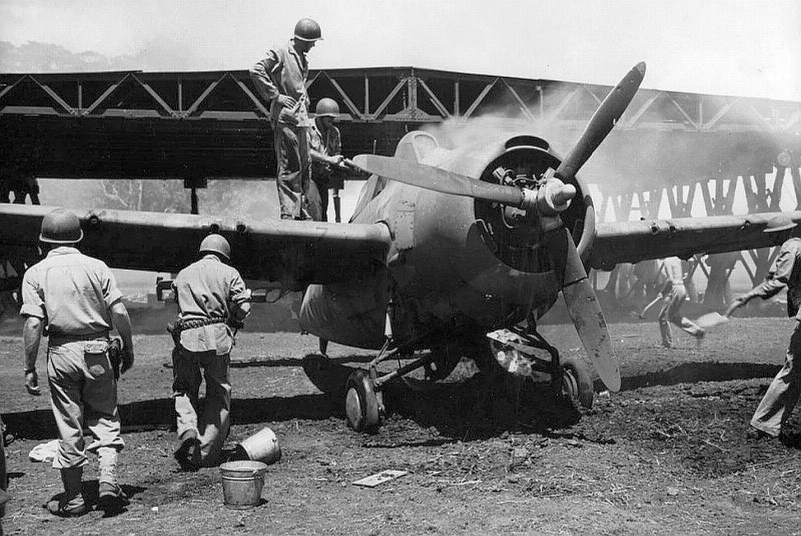 Grumman F4F 3 Wildcat US Marines helping to put out an engine fire Henderson Field Guadalcanal 1942 01