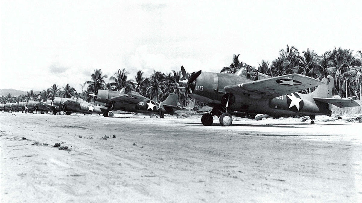 Grumman F4F 3 Wildcats White 28 and 26 lined up along the strip Henderson Field Guadalcanal Jan 1943 01