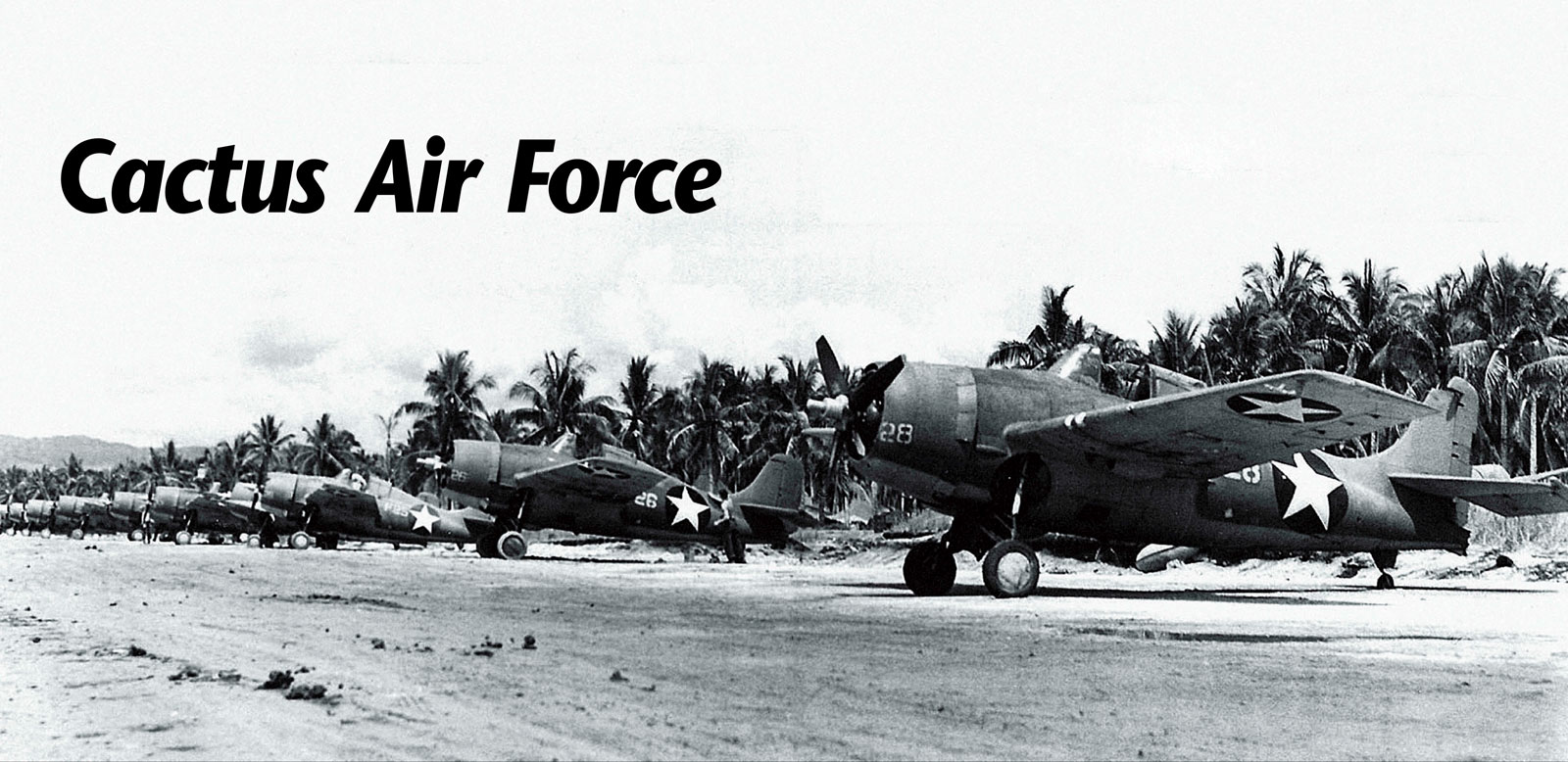 Grumman F4F 3 Wildcats White 28 and 26 lined up along the strip Henderson Field Guadalcanal Jan 1943 02