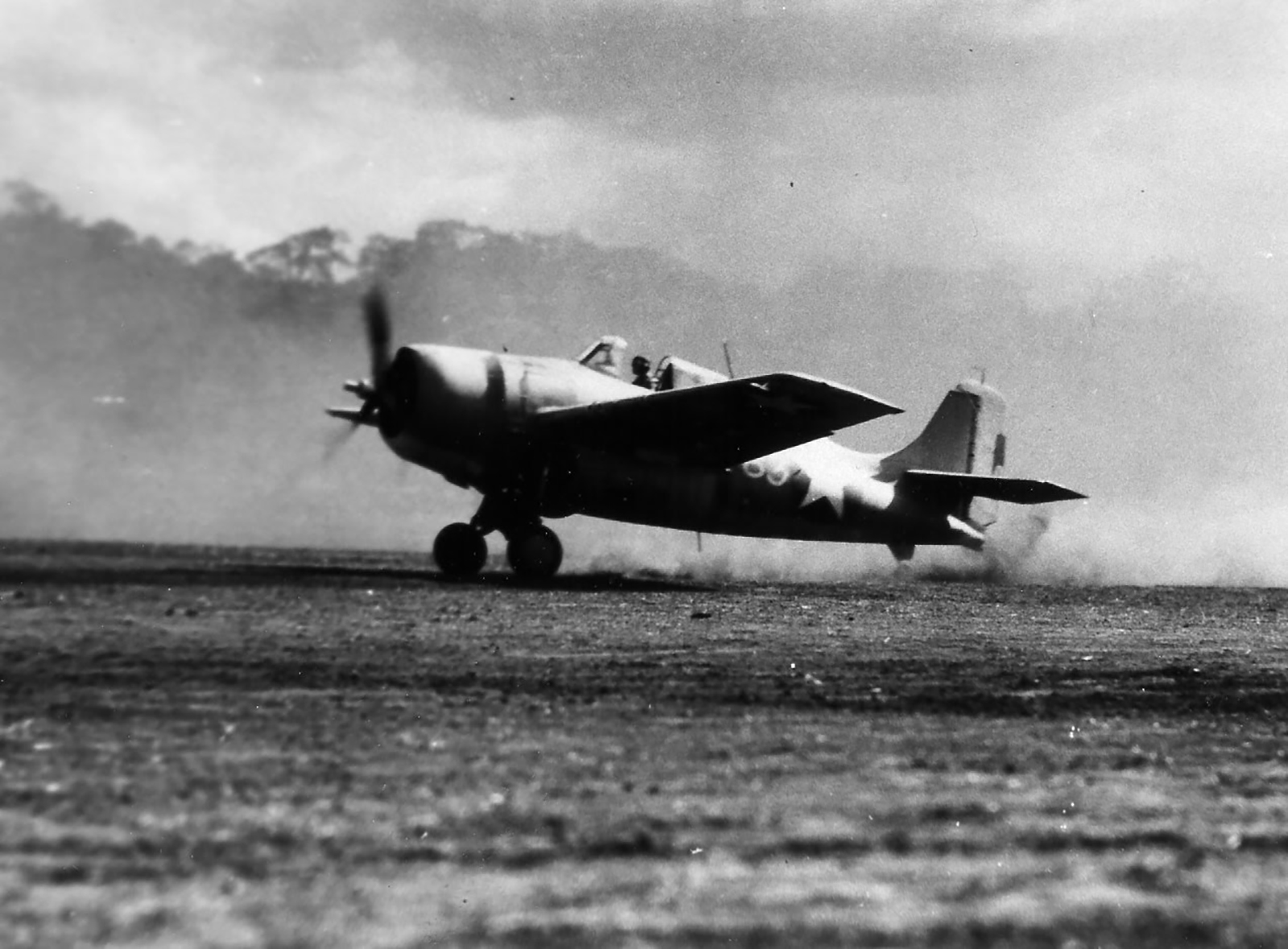 Grumman F4F 3 Wildcats blowing dust every where as it begins to take off Guadalcanal 1943 01