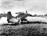 Asisbiz Grumman F4F 3 Wildcat with undercarriage problem Henderson Field Guadalcanal 1942 01