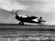 Asisbiz Grumman F4F 3 Wildcats blowing dust every where as it begins to take off Guadalcanal 1943 01